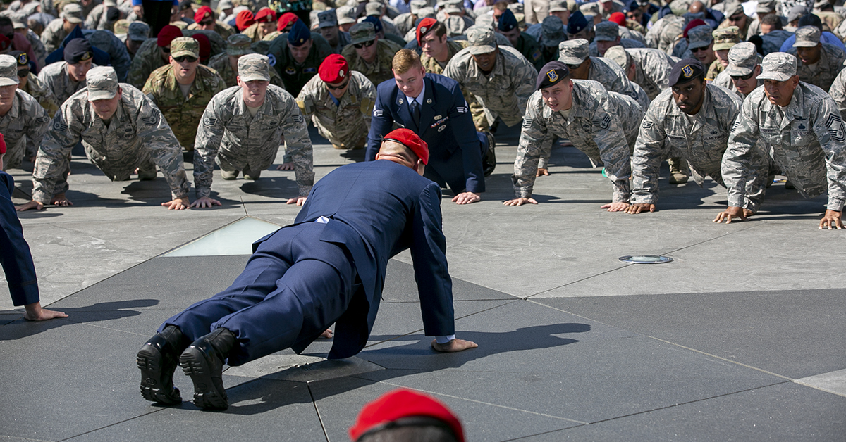 Hundreds of Airmen did pushups in honor of Air Force combat controller Technical Sgt. John Chapman after a Medal of Honor unveiling ceremony at the Air Force Memorial. Chapman, who was posthumously awarded the Medal of Honor Wednesday for actions on Takur Ghar mountain in Afghanistan on March 4, 2002. (Alan Lessig/Staff)
