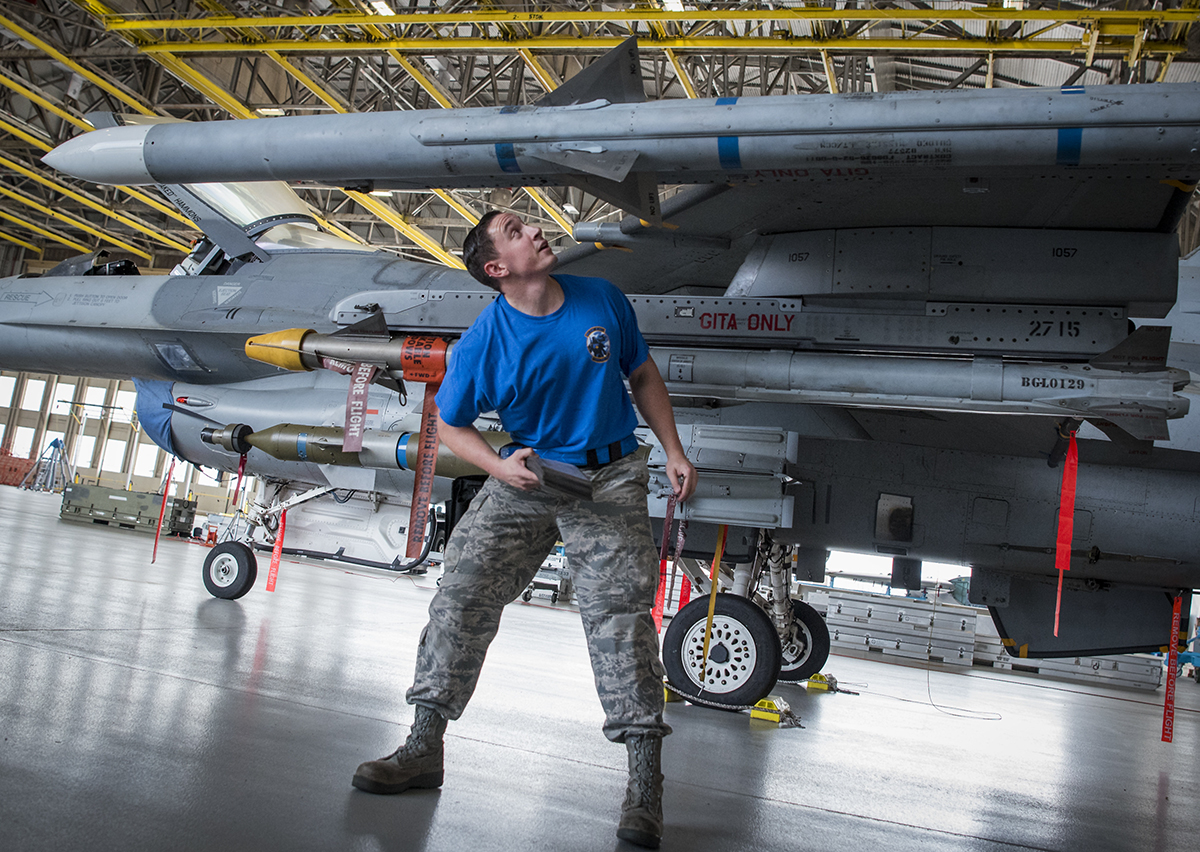 Staff Sgt. Trey Riley, with the 96th Aircraft Maintenance Squadron blue team, performs load checks on his F-16 Fighting Falcon at Eglin Air Force Base, Florida. (Samuel King Jr./Air Force)