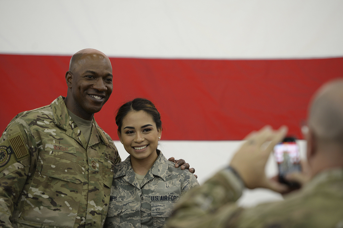 Chief Master Sgt. of the Air Force Kaleth O. Wright poses for a photo with an airman after an all call at Baker Field House on Eielson Air Force Base, Alaska, June 12, 2019. (Senior Airman Kahdija Slaughter/Air Force)