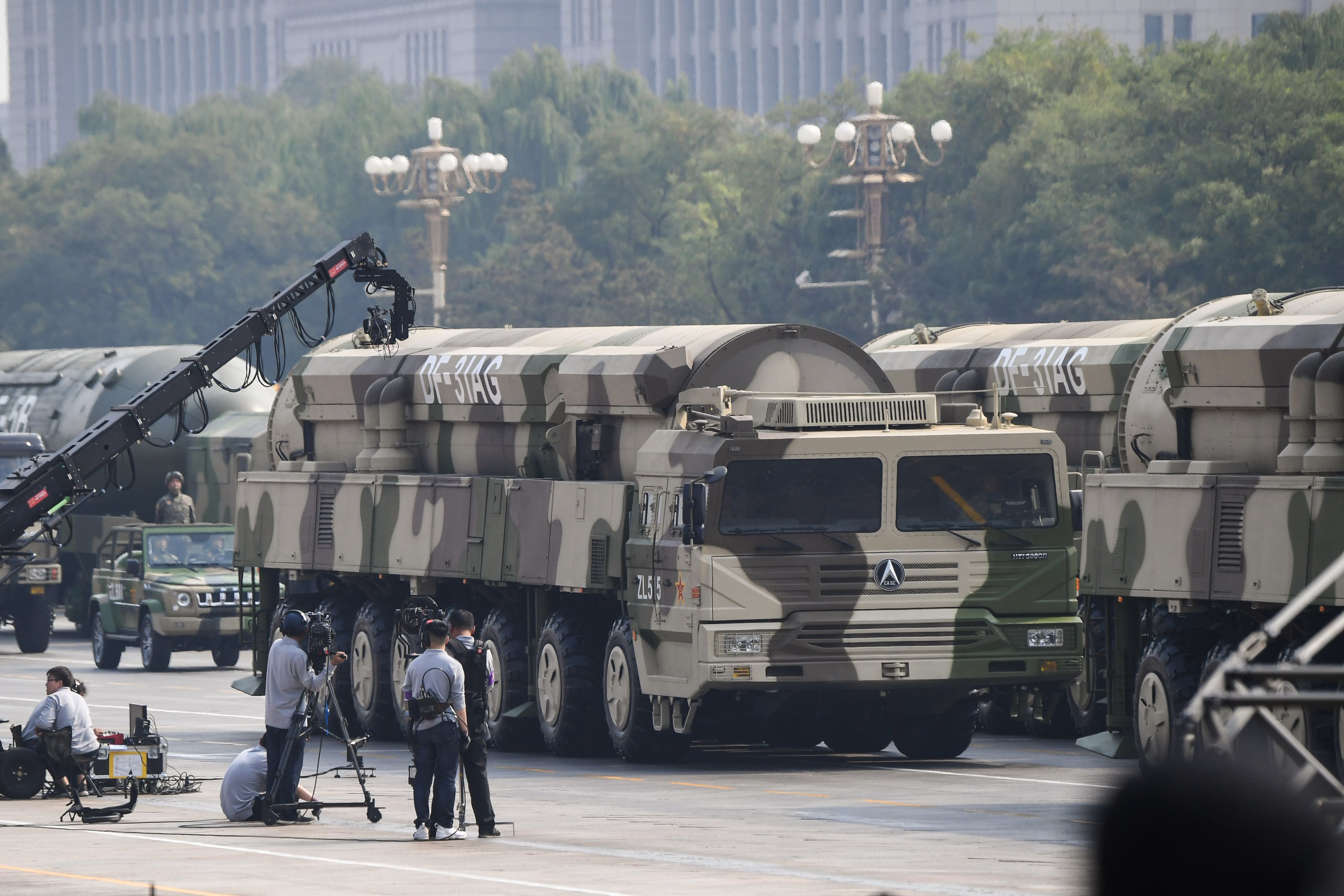 Military vehicles carry DF-31AG intercontinental ballistic missiles during a military parade at Tiananmen Square in Beijing. (Greg Baker/AFP via Getty Images)