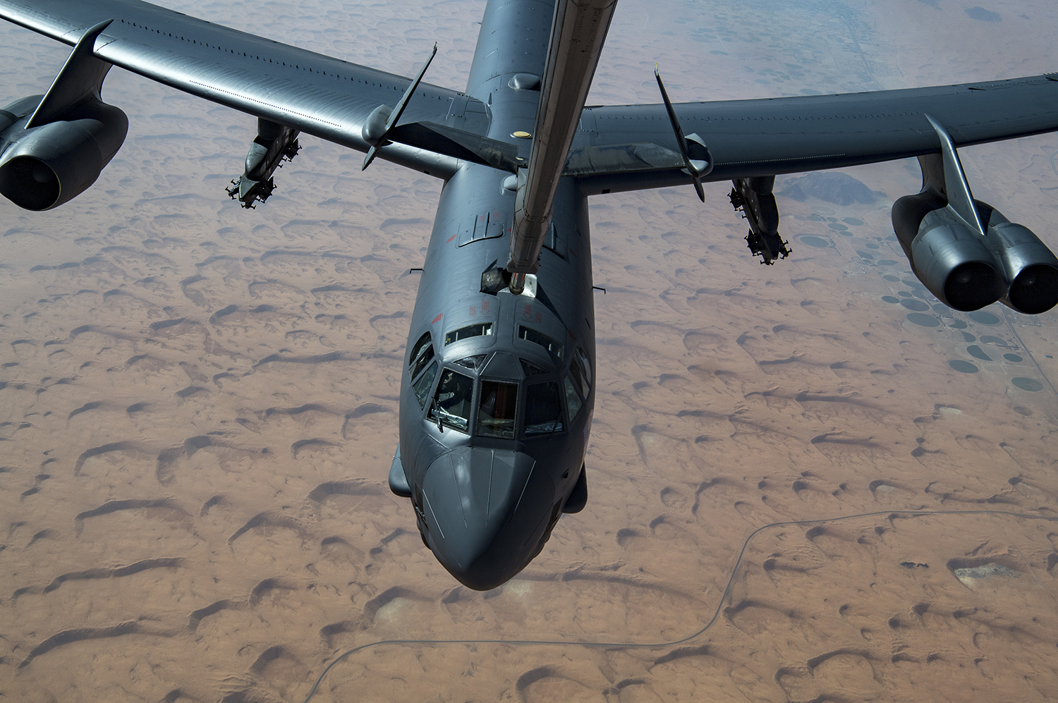 A U.S. Air Force B-52H Stratofortress receives fuel via aerial refueling from a KC-10 Extender above the Arabian Gulf, Nov. 1, 2019. (Staff Sgt. Daniel Snider/Air Force)