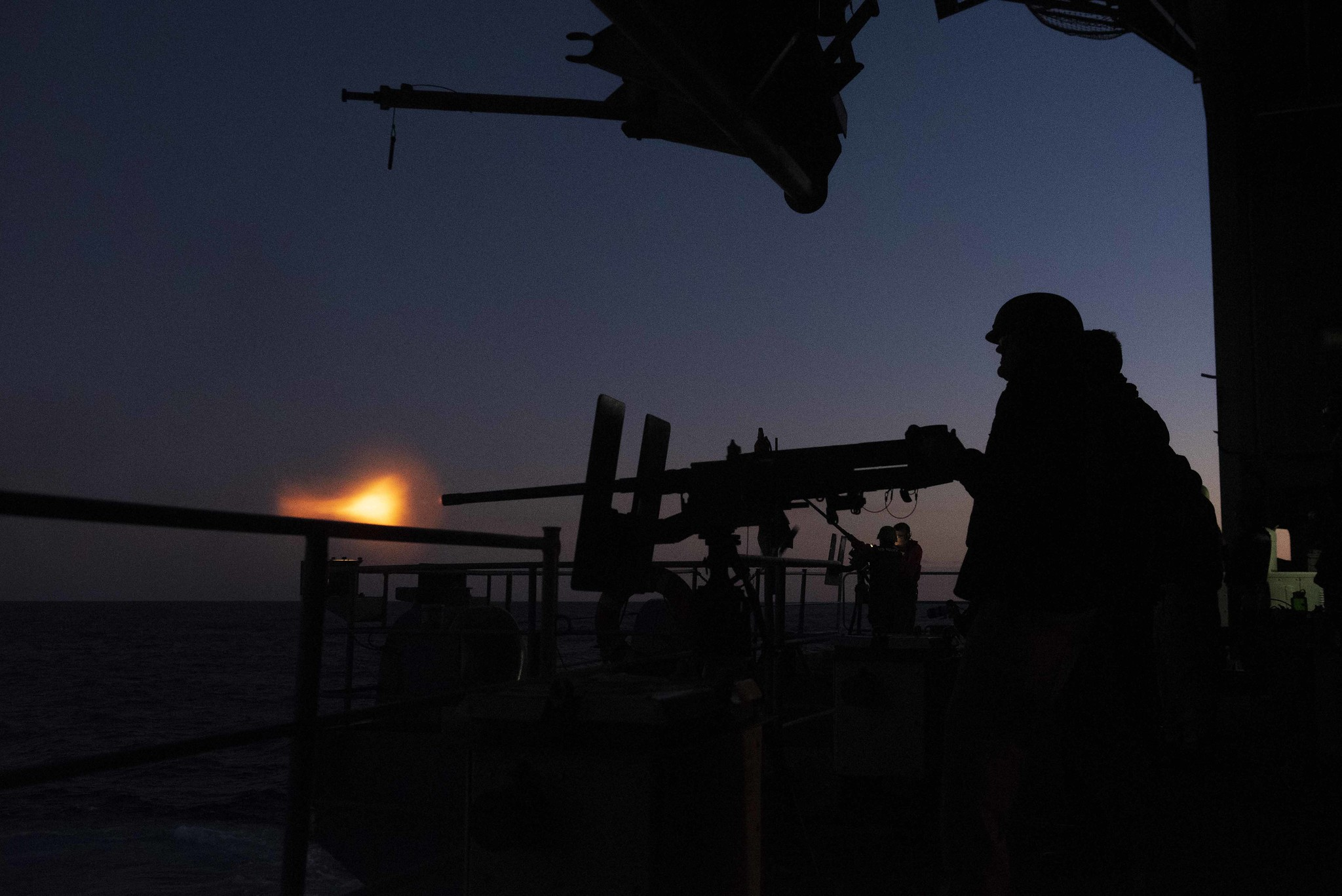 Sailors fire a .50-caliber machine gun Nov. 22, 2019, during a live-fire exercise on the fantail of the Nimitz-class aircraft carrier USS Harry S. Truman (CVN 75) in the Atlantic Ocean. (Mass Communication Specialist Seaman Victoria Sutton/Navy)