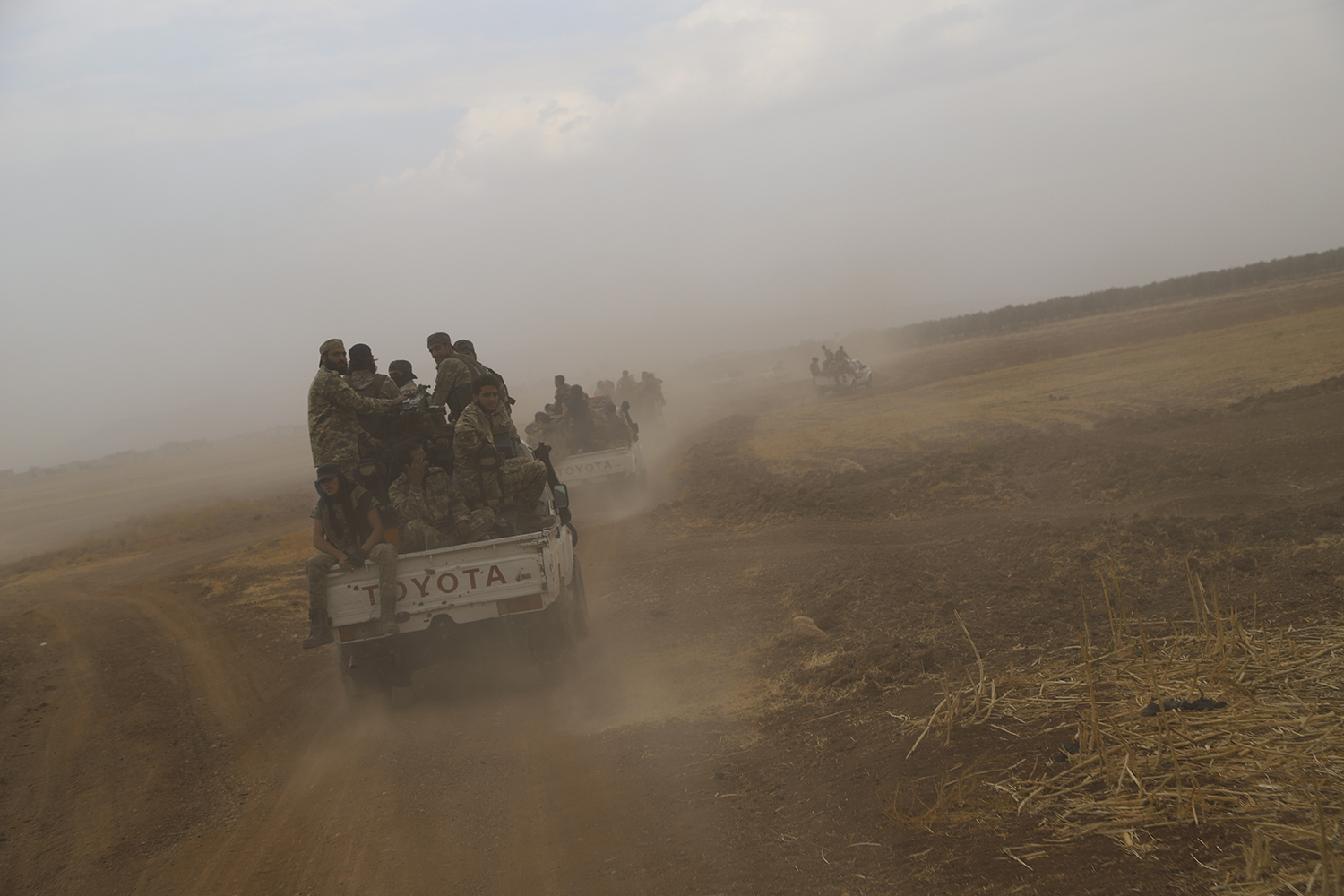 A convoy of Turkish-backed Free Syria Army is about to cross into Turkey near the town of Azaz, Syria, Wednesday, Oct. 16, 2019. (AP)