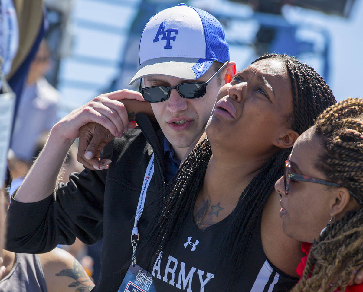 U.S. Army Spc. Stephanie Johnson, is assisted by medical staff after crossing the finish line during Warrior Games at the United States Air Force Academy, Colorado Springs, Colorado, June 2, 2018. (Spc. Connor Kelly/Army)