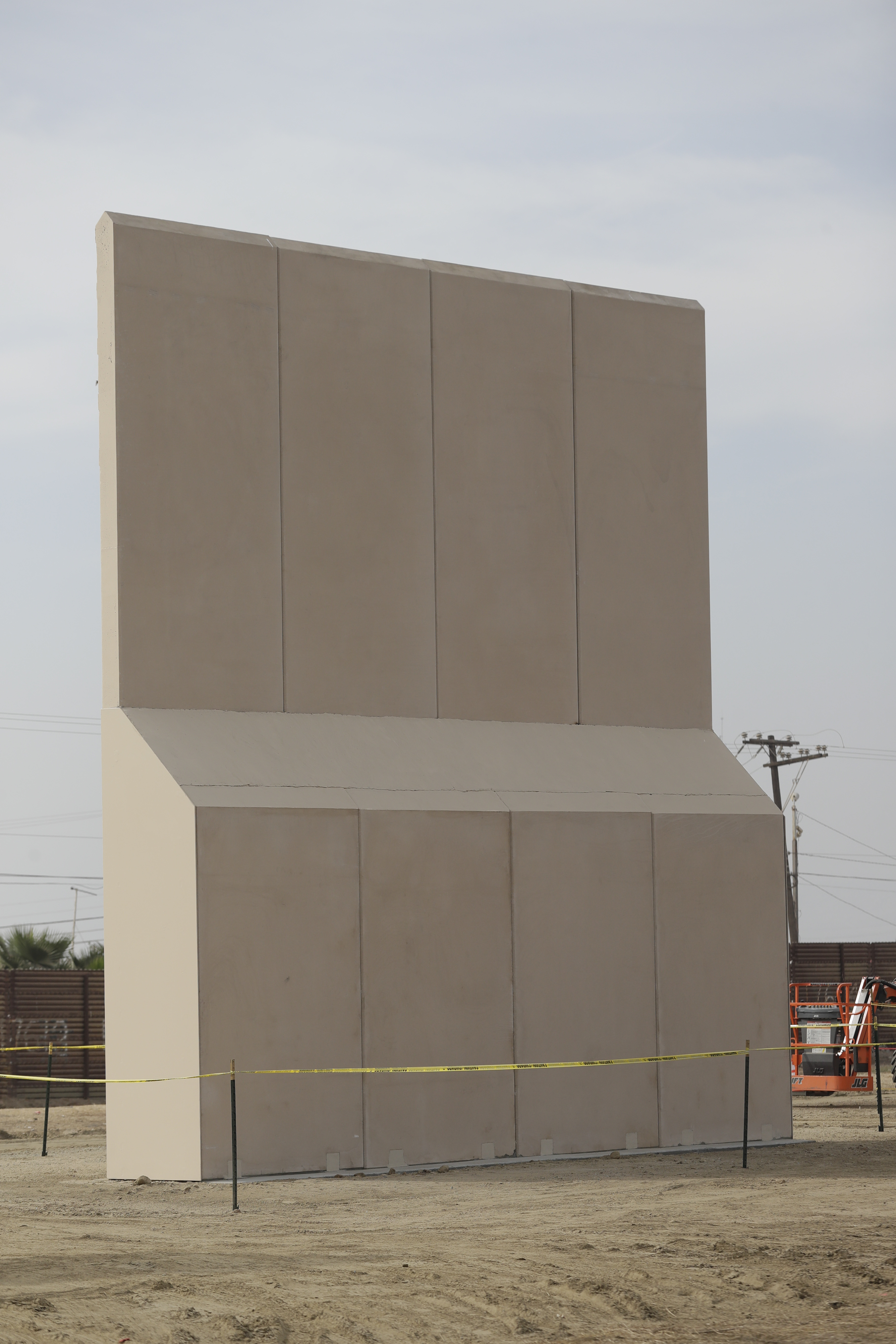 Cadell Construction Company, based in Montgomery, Ala., offered a tan concrete wall at a contract value of $344,000. It's thick at the bottom and narrows considerably toward the pointed top. (Gregory Bull/AP)