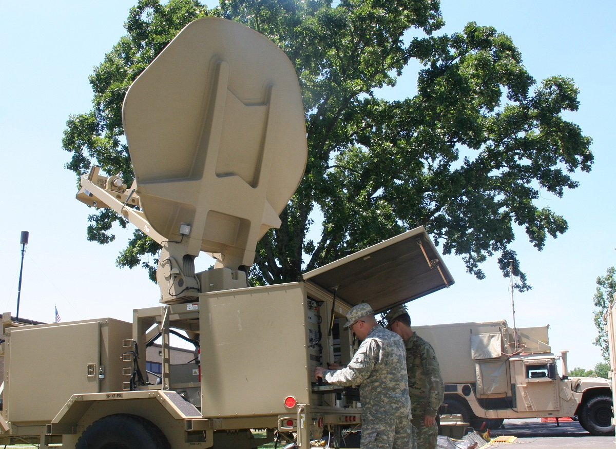 Soldiers from the Delaware Army National Guard 198th Expeditionary Signal Battalion work on a tactical network Satellite Transportable Terminal during a Disaster Incident Response Emergency Communications Terminal (DIRECT) demonstration in Little Rock, Arkansas. (Amy Walker/Army PEO C3T Public Affairs)