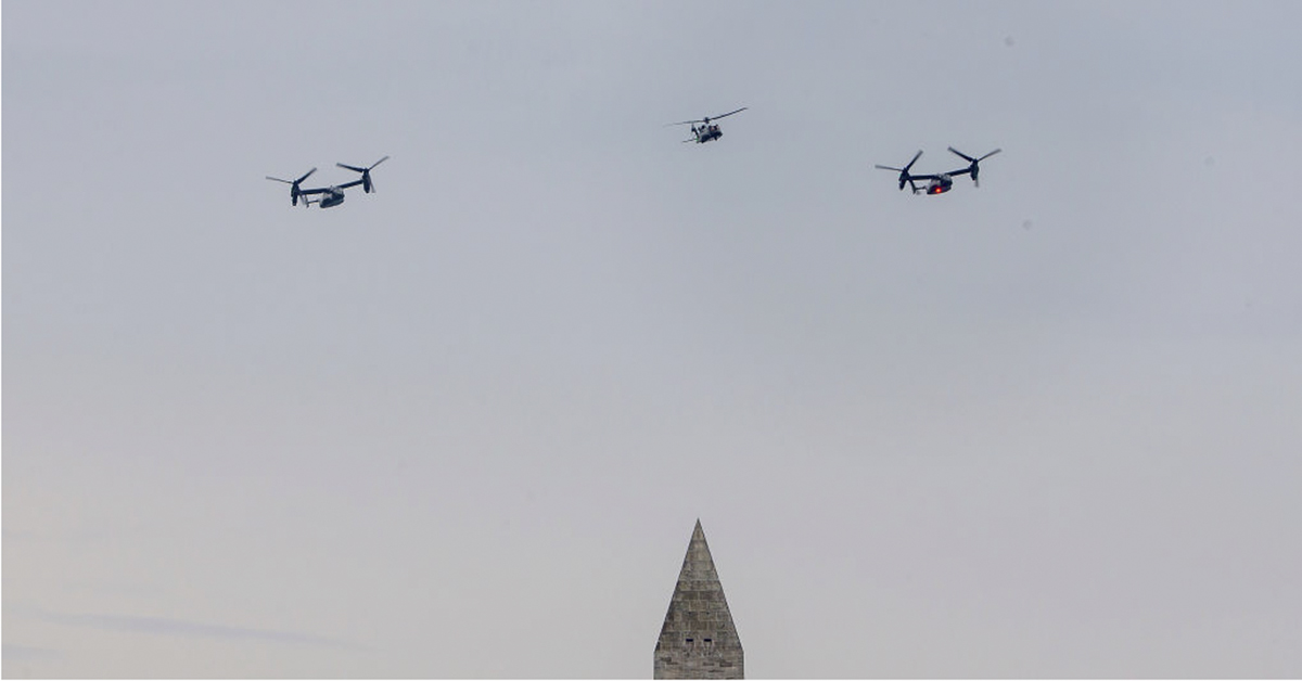 A flyover of the new Marine One VH-92, center, and Osprey's on the mall on July 04, 2019 in Washington, DC. President Trump is holding a