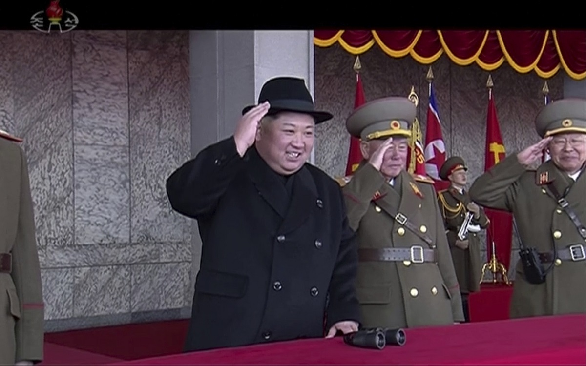 North Korean leader Kim Jong Un, in black, attends a military parade in Pyongyang, North Korea, on Feb. 8, 2018. (Korean Central Television via AP)