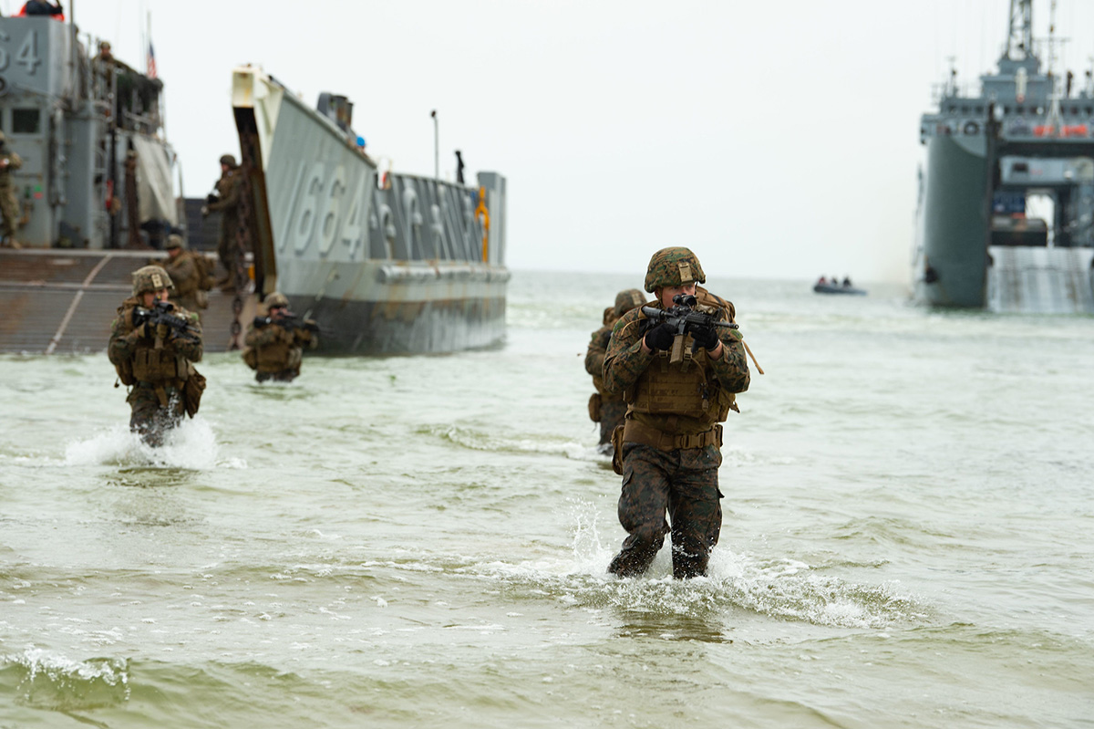 U.S. Marines wade ashore from a landing craft, utility on June 16, 2019, during an amphibious assault for exercise Baltic Operations (BALTOPS) 2019 in Klaipeda, Lithuania. (Mass Communication Specialist 3rd Class Jack D. Aistrup/Navy)