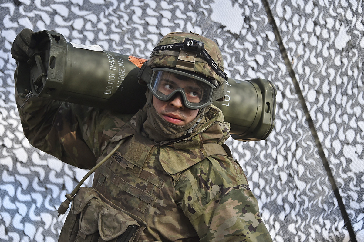 U.S. Army Pvt. Daniel Nieves with Archer Battery, Field Artillery Regiment, 2d Cavalry Regiment carries propellant charges for M777 Howitzers during Exercise Dynamic Front 18 at the U.S. Army's Grafenwoehr Training Area (Germany), March 08, 2018. Exercise Dynamic Front 18 includes approximately 3,700 participants from 26 nations at the U.S. Army's Grafenwoehr Training Area (Germany), Feb. 23-March 10, 2018. Dynamic Front is an annual U.S. Army Europe (USAREUR) exercise focused on the interoperability of U.S. Army, joint service and allied nation artillery and fire support in a multinational environment, from theater-level headquarters identifying targets to gun crews pulling lanyards in the field. (Gertrud Zach/Army)
