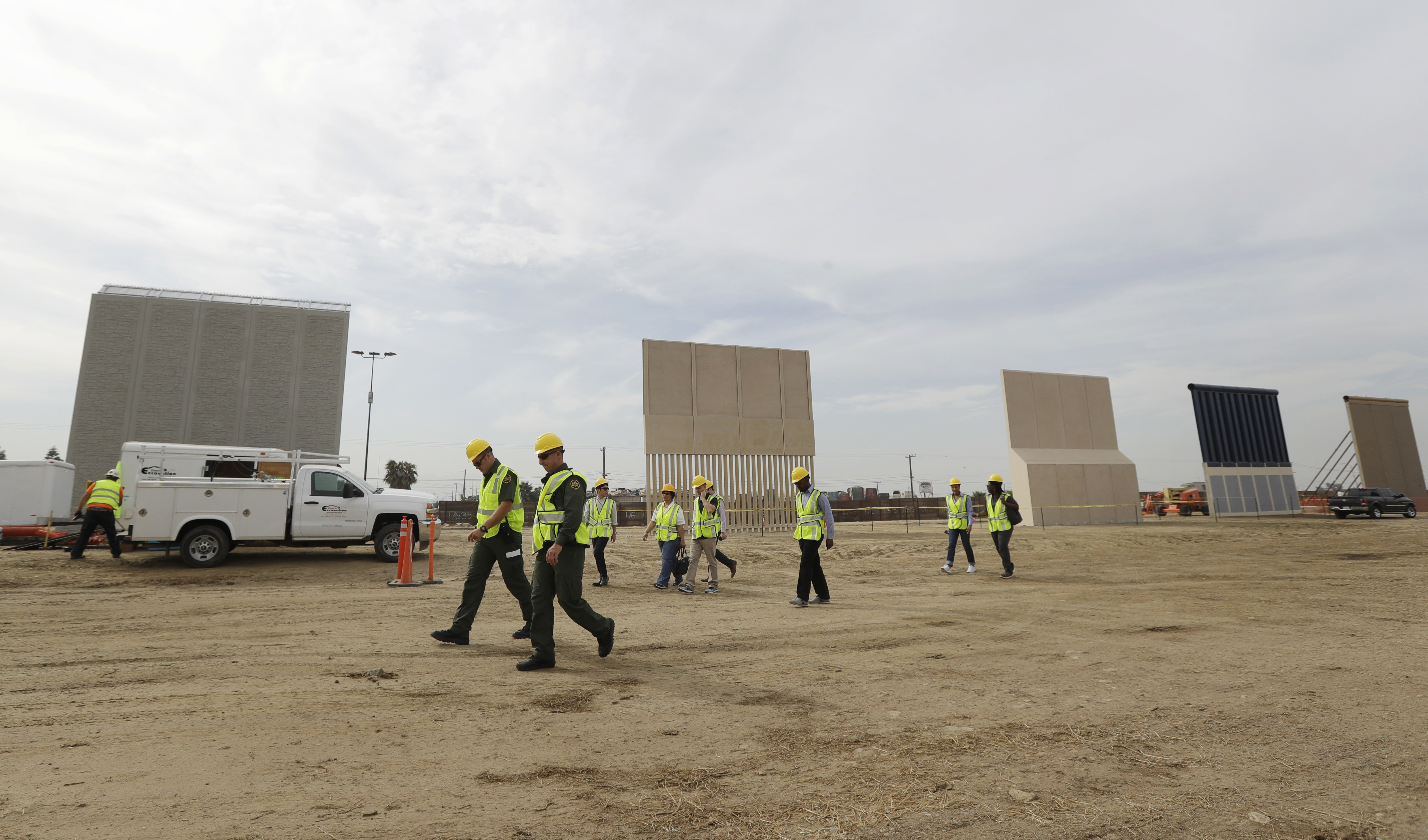 Crews work on a border wall prototype near the border with Tijuana, Mexico, on Oct. 19, 2017, in San Diego. Companies are nearing an Oct. 26 deadline to finish building eight prototypes of President Donald Trump's proposed border wall with Mexico. (Gregory Bull/AP)