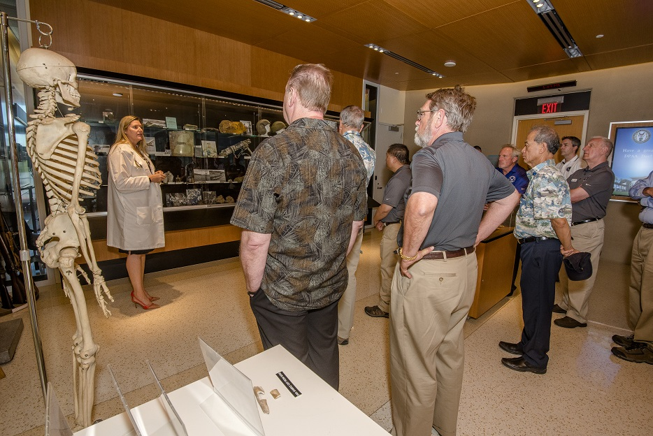 Dr. Debra P. Zinni, laboratory manager at Defense POW/MIA Accounting Agency, briefs officials on the process of identifying remains of service members during a tour of DPAA facilities at Joint Base Pearl Harbor-Hickam in Hawaii on April 23, 2018. (Sgt. Kelly L. Street/Marine Corps)