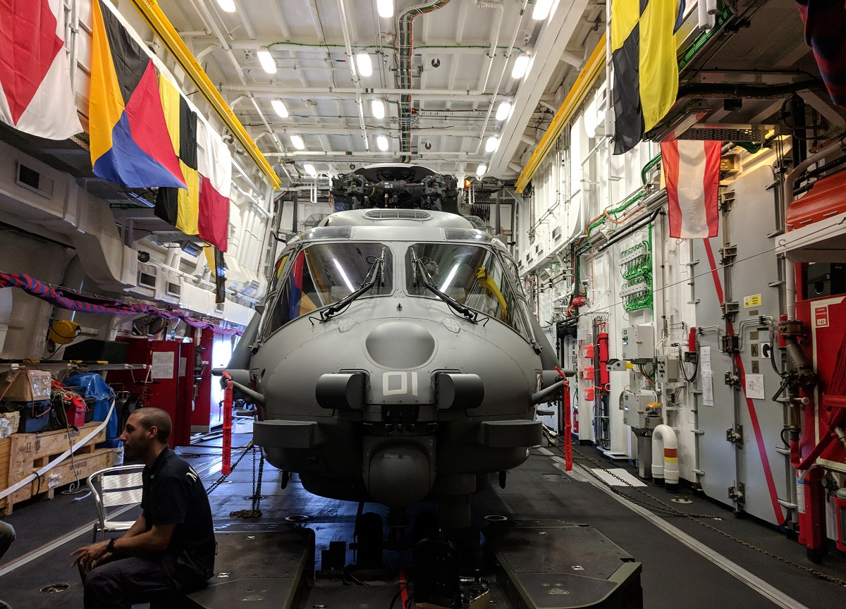 One of the two bays in the Alpino's helicopter hanger has an NH90 folded up inside. (David B. Larter/Staff)