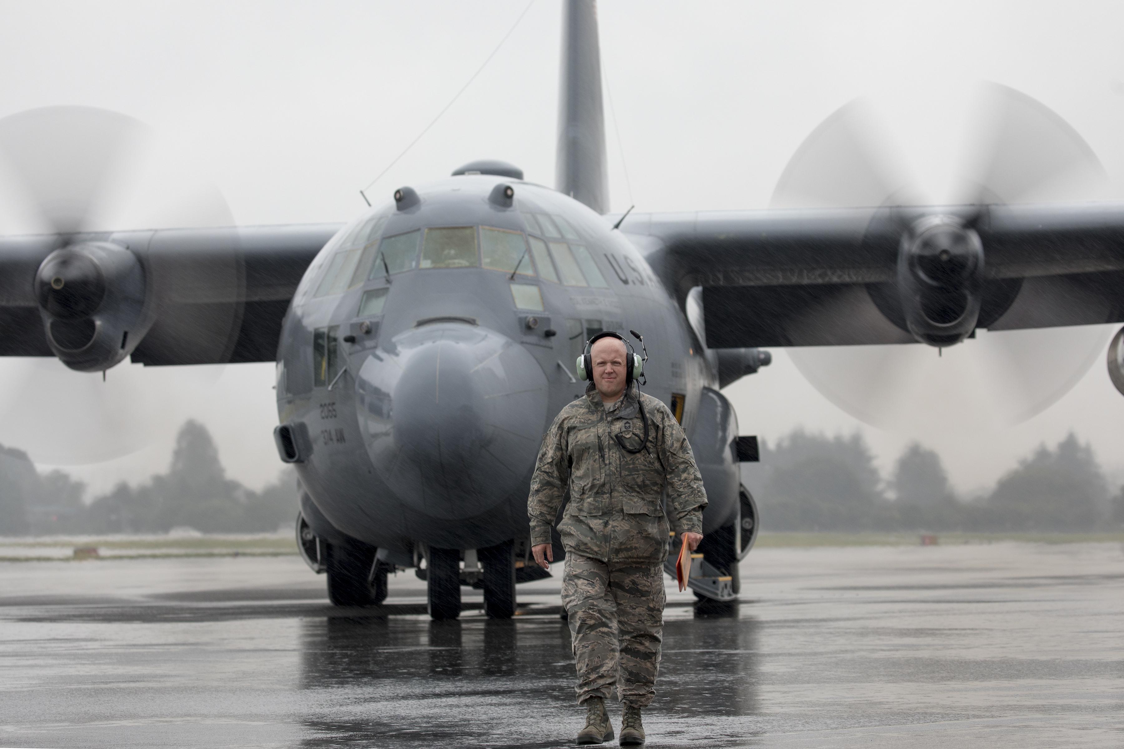 Chief Master Sgt. Eric Evers, 374th Aircraft Maintenance Squadron superintendent, walks on a ramp as he marshals a C-130H Hercules at Yokota Air Base, Japan, Oct. 16, 2017. (Yasuo Osakabe/Air Force)