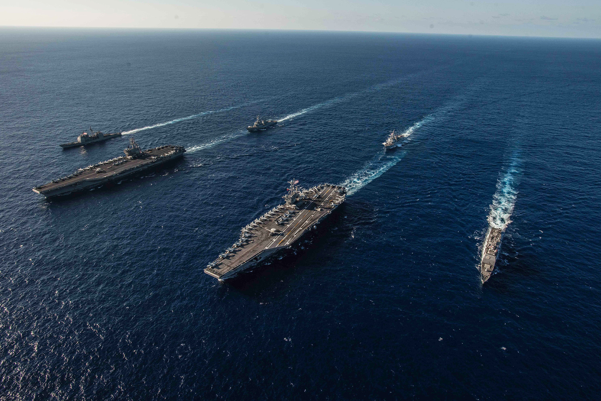 Ships with the Ronald Reagan Carrier Strike Group and John C. Stennis Carrier Strike Group transit the Philippine Sea on Nov. 16, 2018, during dual carrier operations. (MC2 Kaila V. Peters/Navy)