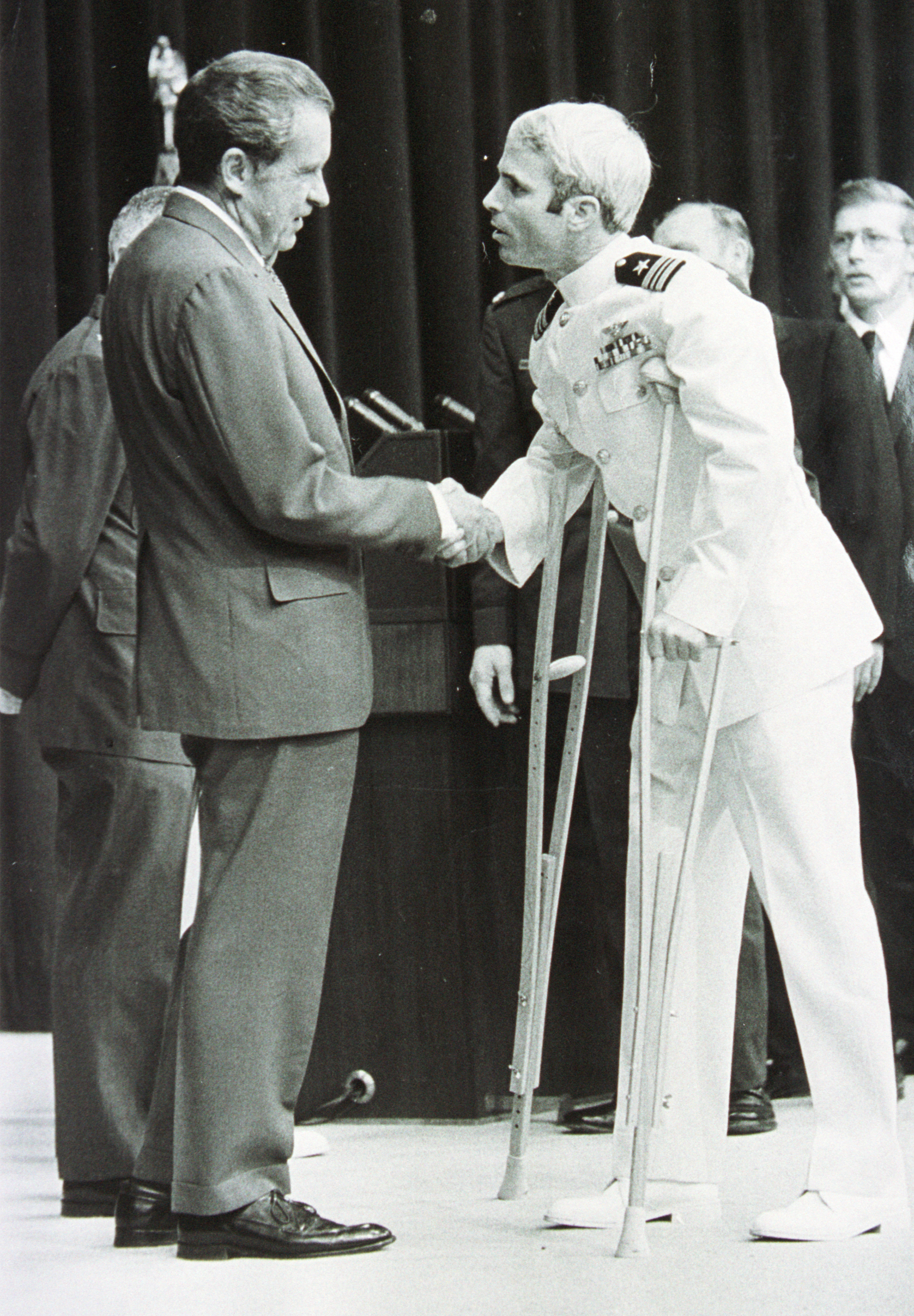 Lt. Cmdr. John McCain is welcomed by U.S. President Richard Nixon on May 24, 1973, in Washington, D.C., upon McCain's release from a POW camp during the Vietnam War. (Getty Images)