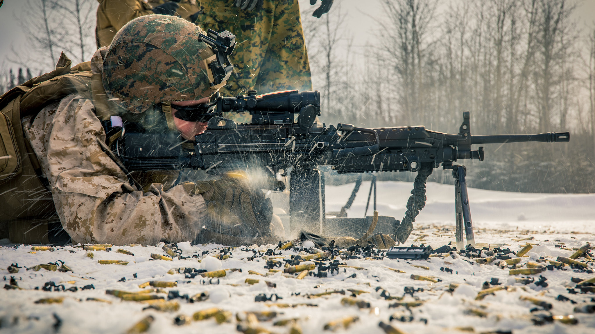 Lance Cpl. Darren J. Duhaime, a small arms repairer/technician with 5th Battalion, 11th Marine Regiment, 1st Marine Division, engages a target with an M249 light machine gun during a machine gun range at Fort Greely, Alaska, Feb. 22, 2020, in preparation for exercise Arctic Edge 2020. (Lance Cpl. Jose Gonzalez/Marine Corps)