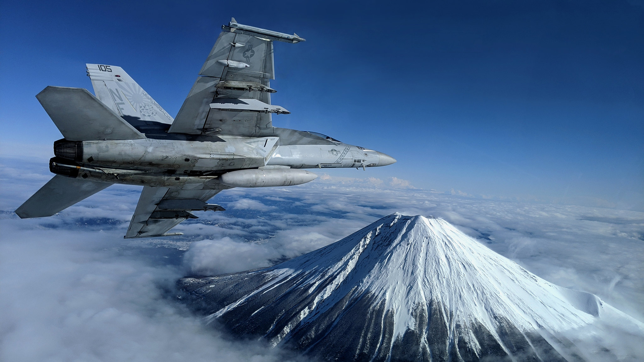 An F/A-18F Super Hornet assigned to Strike Fighter Squadron 102 conducts flight operations near Mount Fuji on Jan. 29, 2020, in Japan. (Lt. Alex Grammar/Navy)