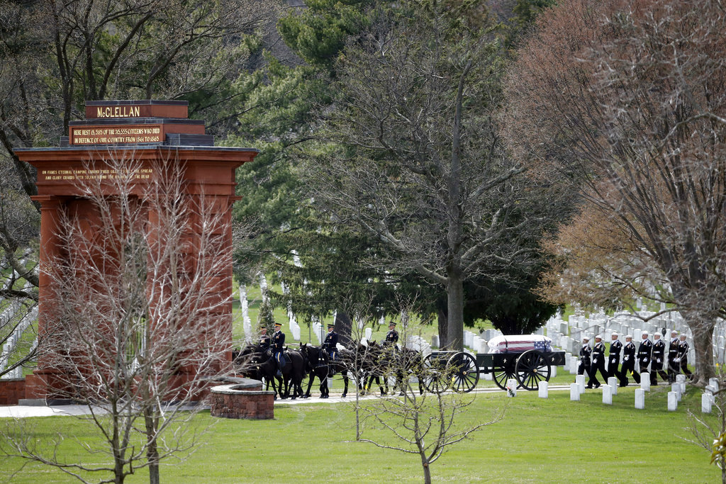 A horse drawn caisson arrives through the McClellan Gate for burial services for Capt. Thomas J. Hudner Jr., a naval aviator and Medal of Honor recipient from Concord, Mass., at Arlington National Cemetery Wednesday, April 4, 2018 in Arlington, Va. Hudner earned the Medal of Honor for his actions in the Battle of the Chosin Reservoir during the Korean War. (Alex Brandon/AP)
