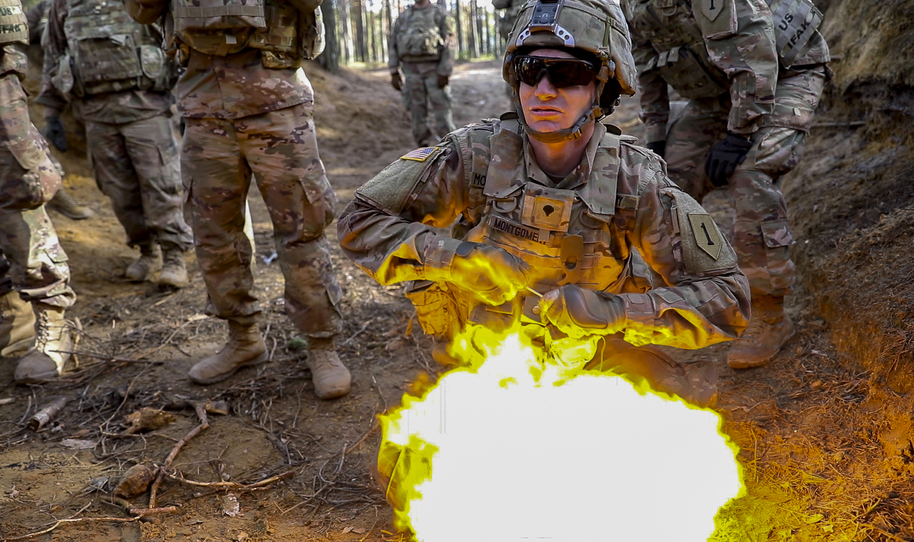 Soldiers from 1st Engineer Battalion, 1st Armored Brigade Combat Team, 1st Infantry Division, take cover March 6, 2019, as a soldier detonates an explosion during live fire explosives training at Joanna range in Zagan, Poland. (Sgt. Thomas Mort/Army)