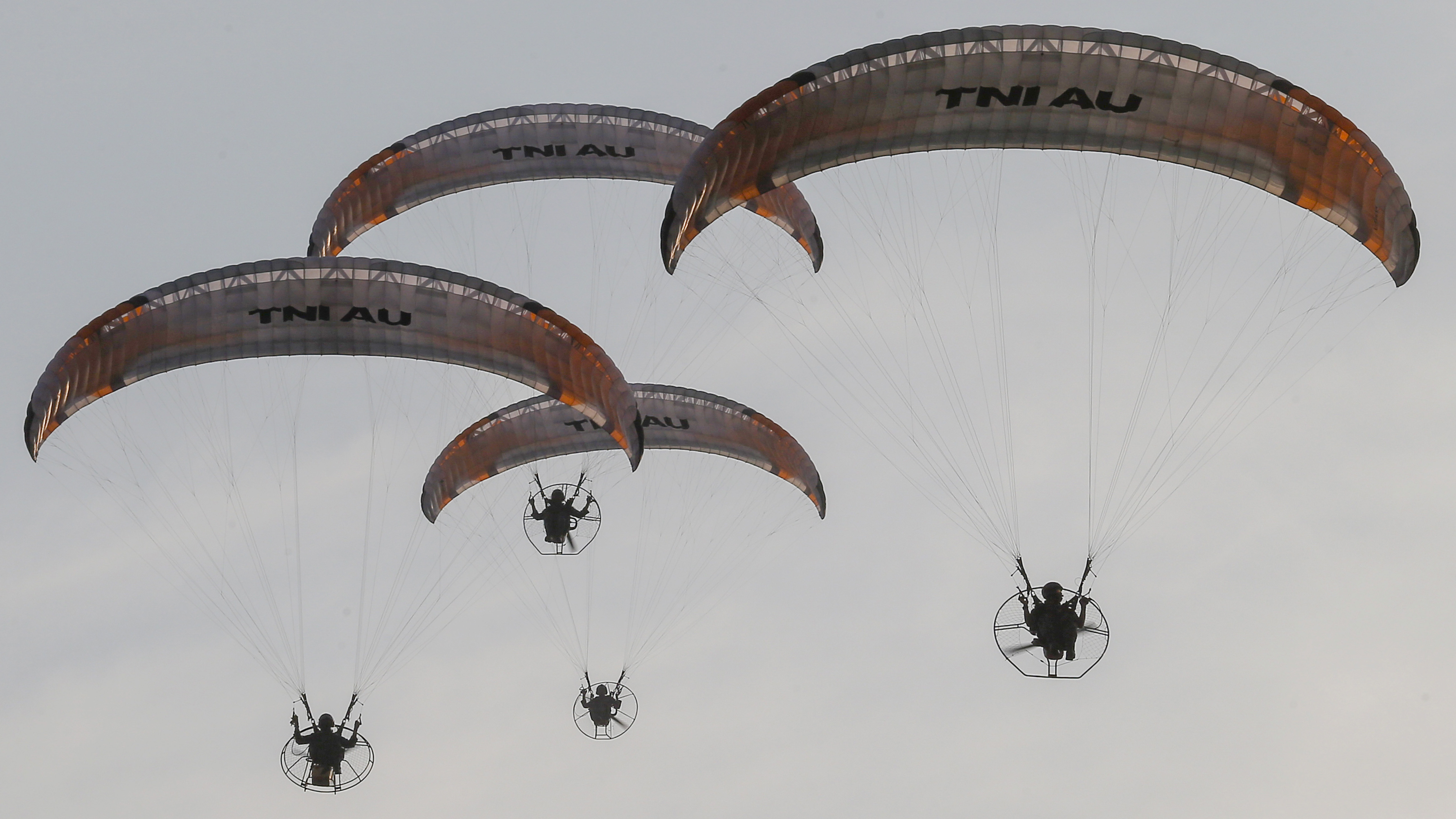 Skydivers perform during a parade marking the 74th anniversary of the Indonesian Armed Forces in Jakarta, Indonesia, Saturday, Oct. 5, 2019. (AP Photo/Tatan Syuflana)