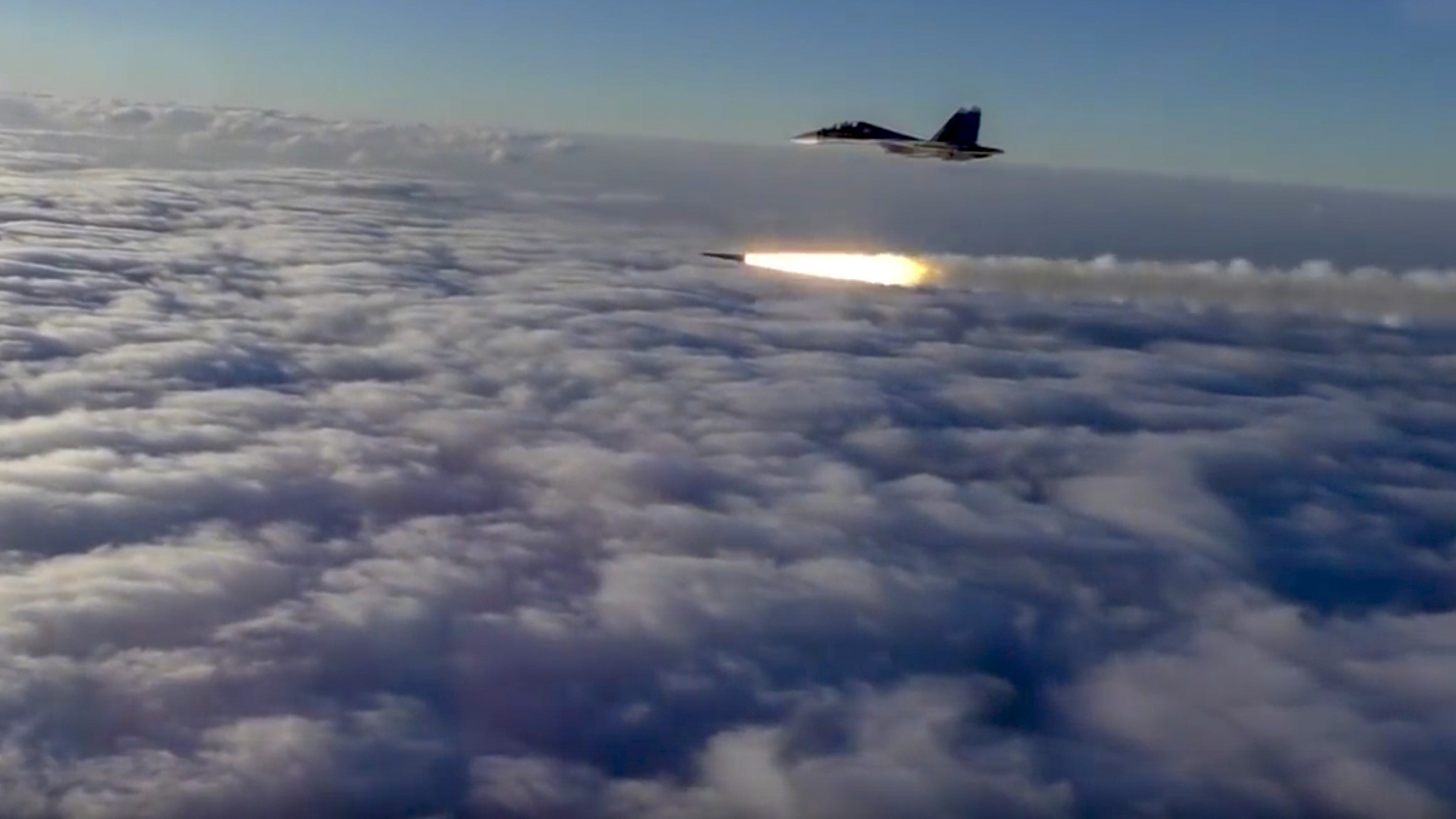 This photo made from the footage taken from Russian Defense Ministry official web site on Thursday, Sept. 27, 2018, An Su-30 fighter jet of the Russian air force launches a missile during maneuvers in southern Russia. The Russian Defense Ministry said the drills included launches of missiles and bombing runs on sea and land targets. (Russian Defense Ministry Press Service via AP)