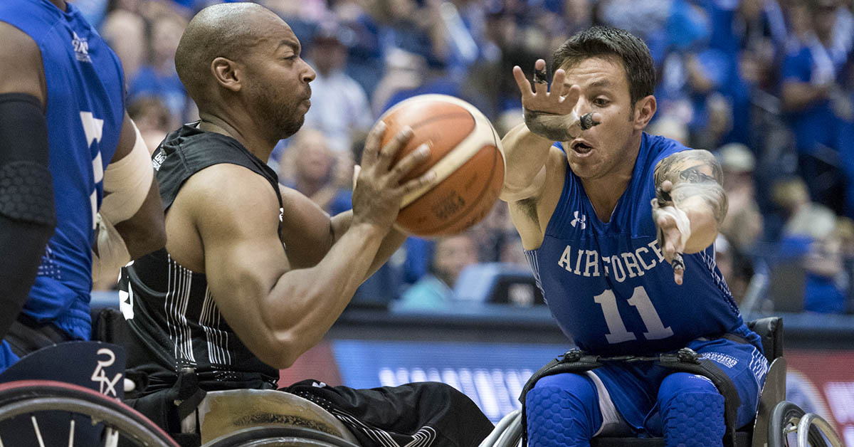 Army Spc. Brent Garlic battles Air Force Master Sgt. Kenneth Guinn for the ball as Army defeats Air Force to win gold in wheelchair basketball, the final event of the 2018 DoD Warrior Games at the U.S. Air Force Academy in Colorado Springs on June 9, 2018. The Warrior Games are an annual event, established in 2010, to introduce wounded, ill and injured service members to adaptive sports as a way to enhance their recovery and rehabilitation. (Roger L. Wollenberg/DoD)