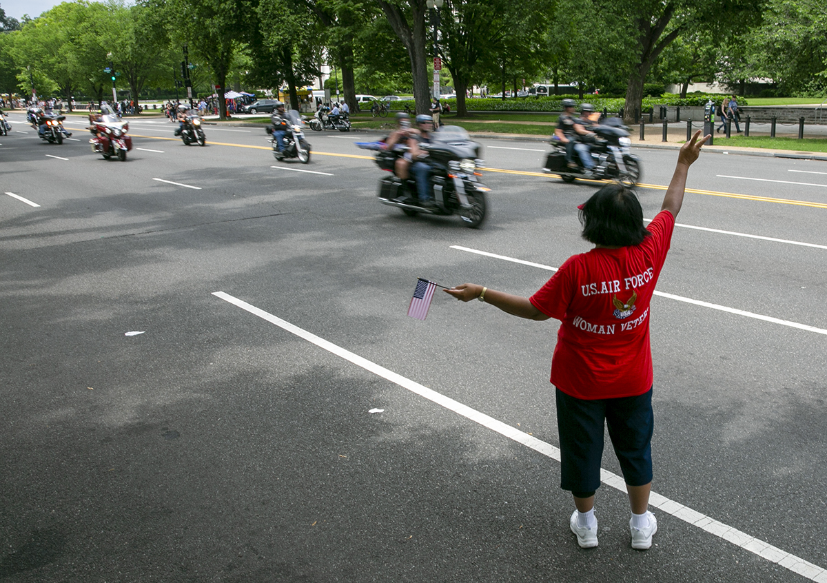 Air Force veteran Anna Sanders from Baton Rouge, LA, shows her support to riders during Rolling Thunder XXXI First Amendment Demonstration Run along Constitution Ave. in Washington, DC on Sunday May 27, 2018. Motorcycle riders from across the nation, rode a designated route through the Mall area of Washington, D.C. The event is an actual demonstration/protest to bring awareness and accountability for POWs and MIAs left behind.(Alan Lessig/Staff)