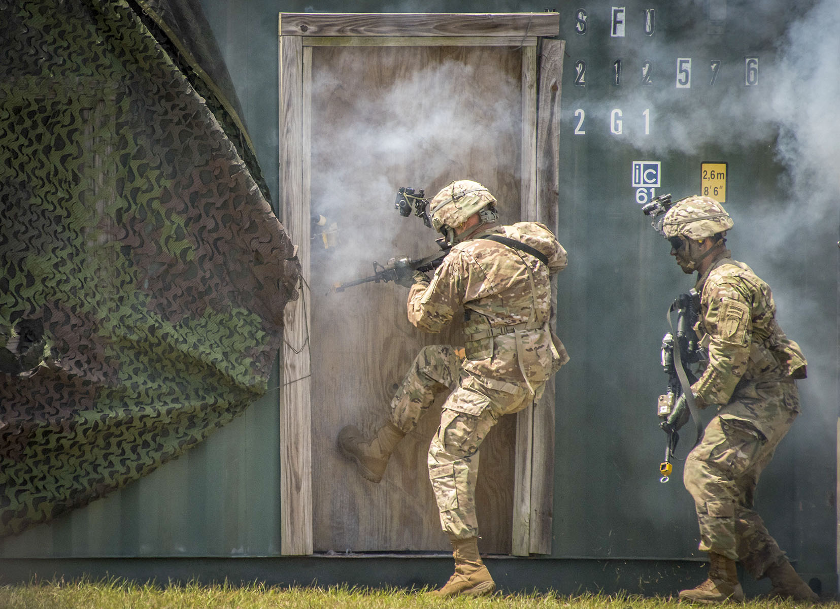 An Army Ranger kicks in a door during a demonstration at the 6th Ranger Training Battalion's open house event May 5, 2018, at Eglin Air Force Base, Fla. The event was a chance for the public to learn how Rangers train and operate. The event displays showed equipment, weapons, a reptile zoo, face painting and weapon firing among others. The demonstrations showed off hand-to-hand combat, a parachute jump, snake show and Rangers in action. (Samuel King Jr./Air Force)