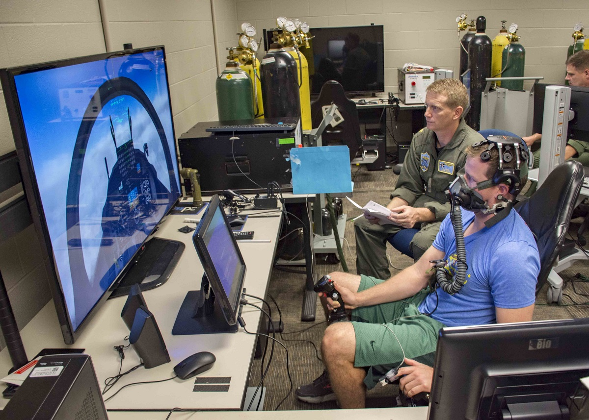 Lt. Clayton Shaw, an instructor pilot from the U.S. Navy's Training Squadron Ten, participates in testing of equipment meant to provide early warning signs to pilots before feeling symptoms of hypoxia. (Mass Communication Specialist 2nd Class Michael J. Lieberknecht/U.S. Navy)