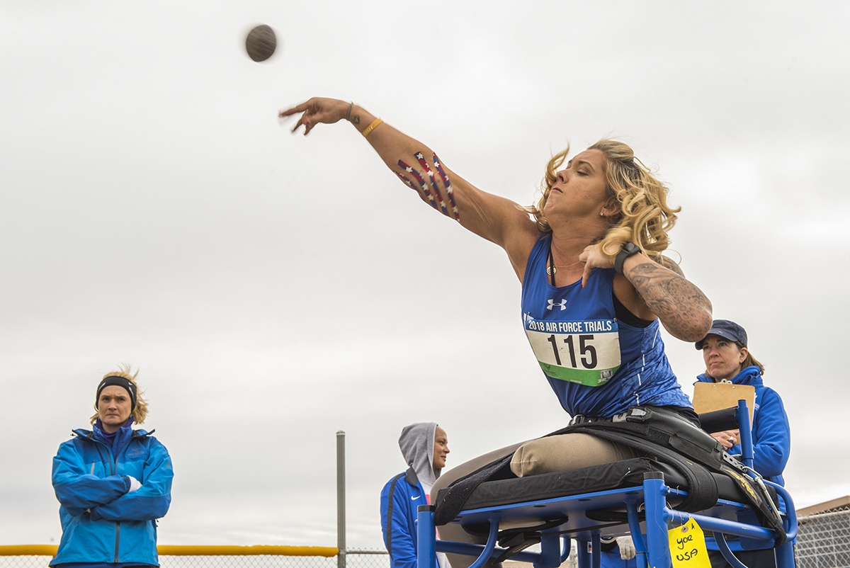 Senior Airman Heather Carter, a wounded warrior athlete, throws a shot put during the track and field competition at the 5th Annual Air Force Wounded Warrior Trials at Nellis Air Force Base, Nev., Feb. 27, 2018. The Air Force Trials is an adaptive and resiliency sports event designed to promote the mental and physical well-being of the participants. (Sr. Airman James R. Crow/Air Force)
