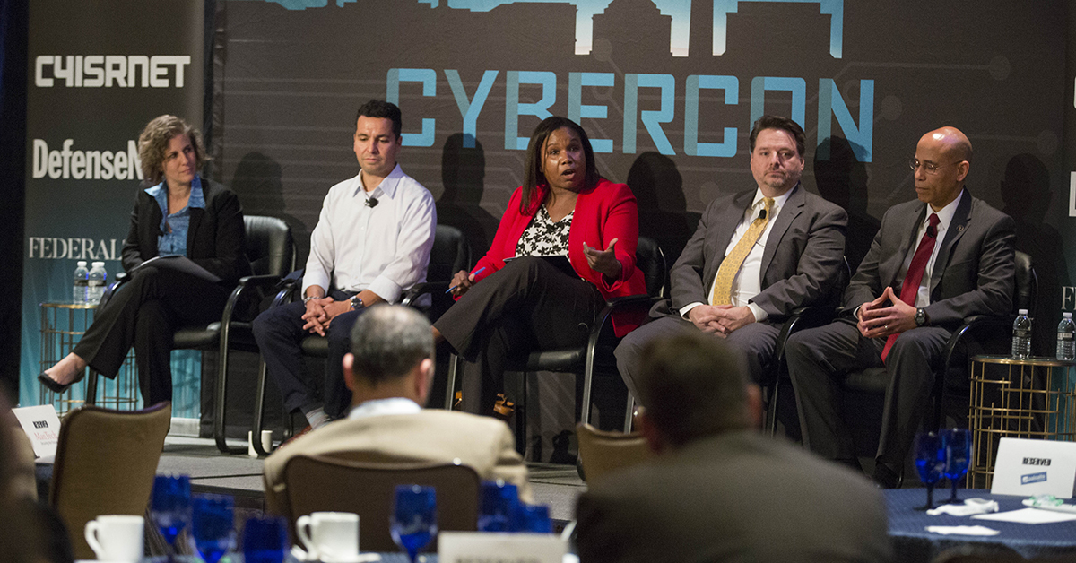 Jill Aitoro moderates a panel: Training on the Edge: with Joey Muniz, Technical Solutions Architect, Cisco, Deborah Pierre-Louis, Director of Policy, Liaison, and Training Office, Department of State, and Harry WIngo, Faculty member at College of Information and cyberspace, National Defense University at Cybercon 2017 at the Ritz-Carlton Hotel in Pentagon City on Nov. 28, 2017. ( Ben Murray/Staff)