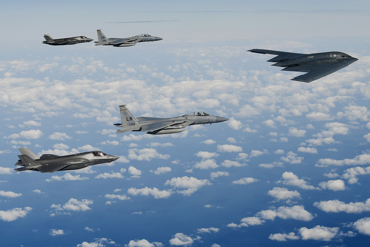 A B-2A Spirit bomber leads a delta formation consisting of two F-15C Eagles and two Royal Air Force F-35B Lightning IIs as they conduct aerial operations over the North Sea, Sept. 16, 2019. (Tech. Sgt. Matthew Plew/Air Force)