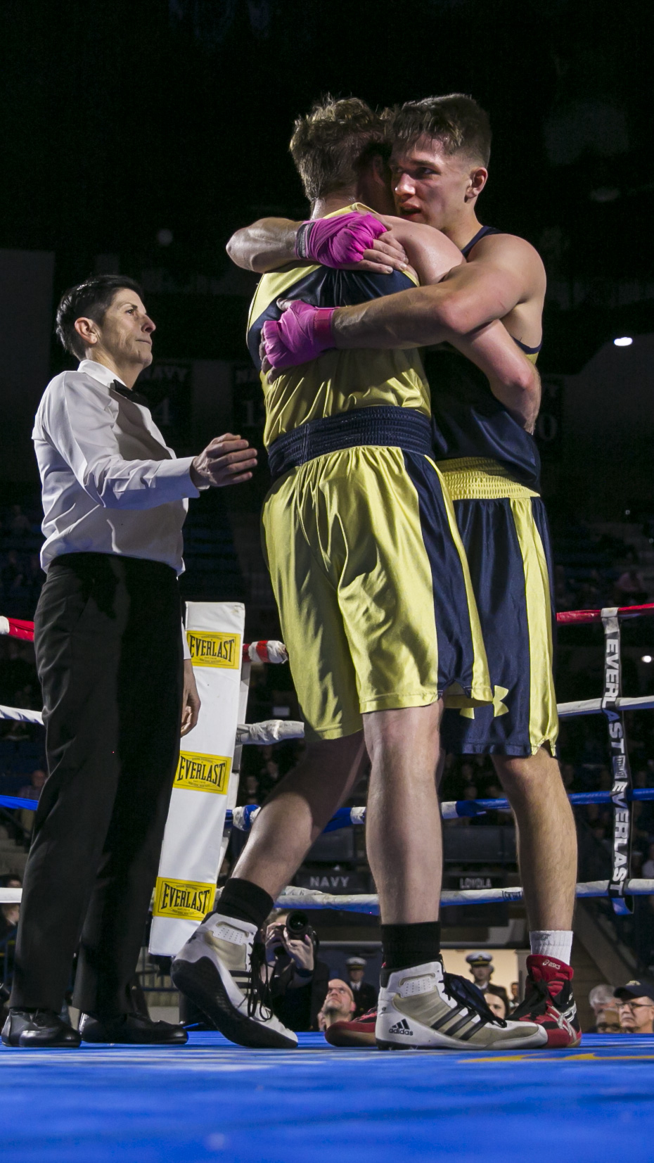 Jay Packer, (in gold) and Charlie Akerblom, (in blue), both from Philadelphia, PA, hug after slugging it out in the 185 lb weight class during the United States Naval Academy's 77th Brigade Boxing Championships held on Feb. 23, 2018. Akerblom won the fight. (Alan Lessig/Staff)
