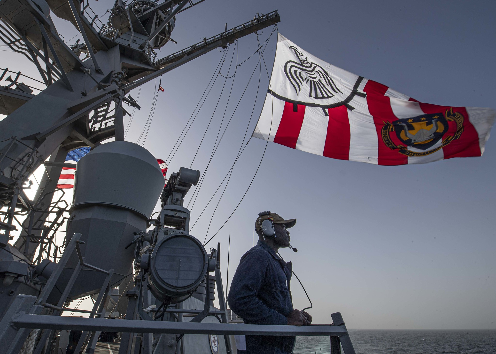 Seaman Divine Owoseni stands watch as the port lookout aboard the guided-missile destroyer Carney (DDG 64) on Feb. 27, 2020, in the Gulf of Oman. (Mass Communication Specialist 1st Class Fred Gray IV/Navy)
