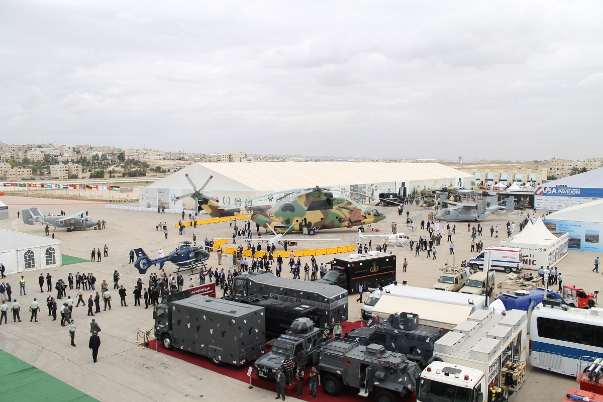 Under unseasonably overcast skies and high winds, SOFEX carried on for three days from May 8-10 in Amman, Jordan. A bird's eye view of the show captures a wide variety of air assets and law enforcement capability in the foreground. (Jen Judson/Staff)