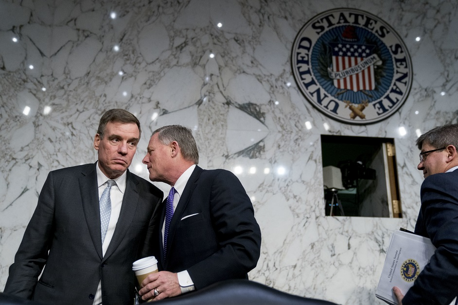 Senate Intelligence Committee Vice Chairman Mark Warner, D-Va., left, wants more intelligence on Chinese threats to American businesses to be declassified. (AP Photo/Andrew Harnik, File)