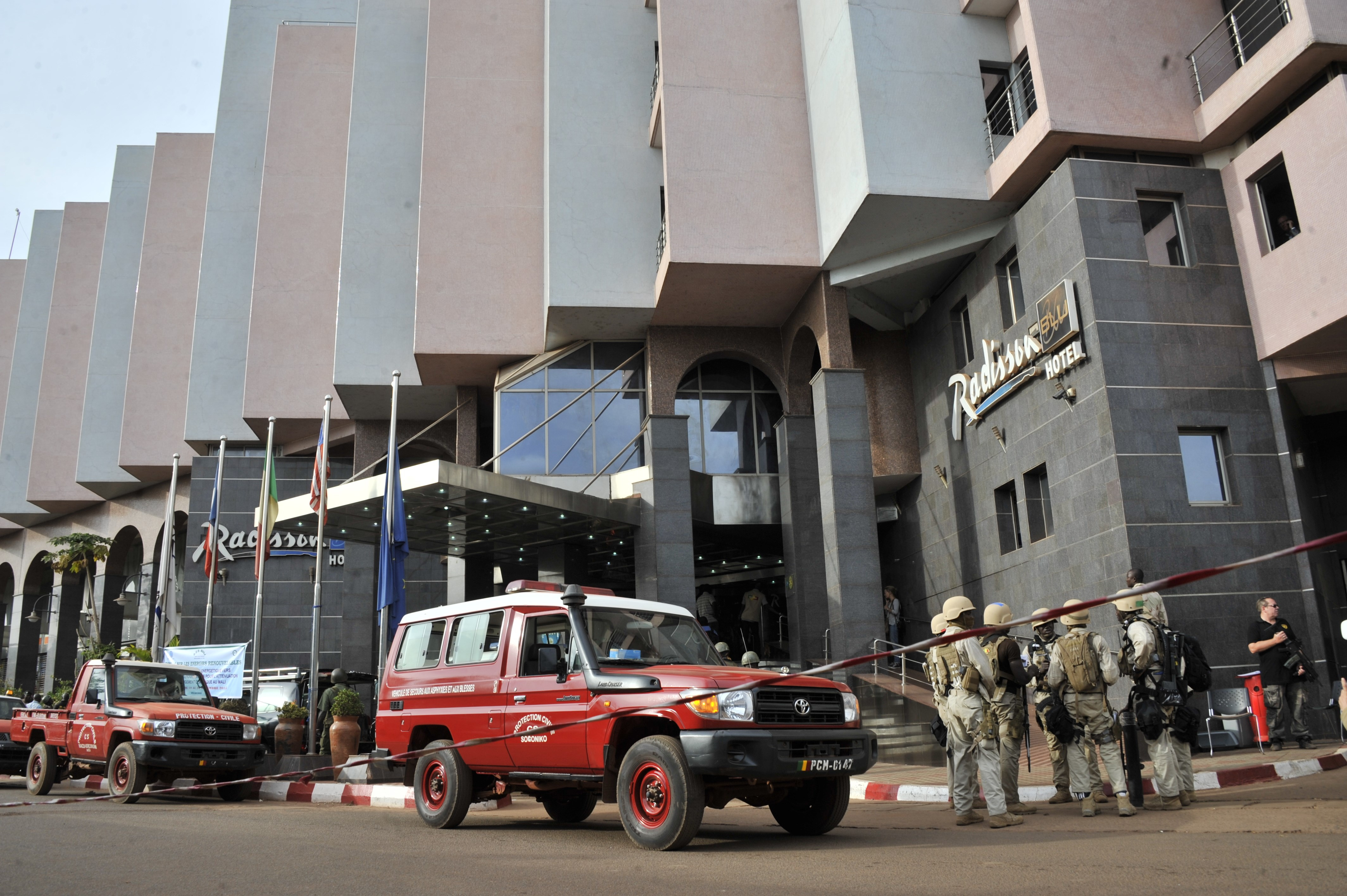 Malian soldiers and special forces stand guard at the entrance the Radisson Blu hotel in Bamako on Nov. 20, 2015, after the assault of security forces. (Habibou Kouyate/AFP/Getty Images)