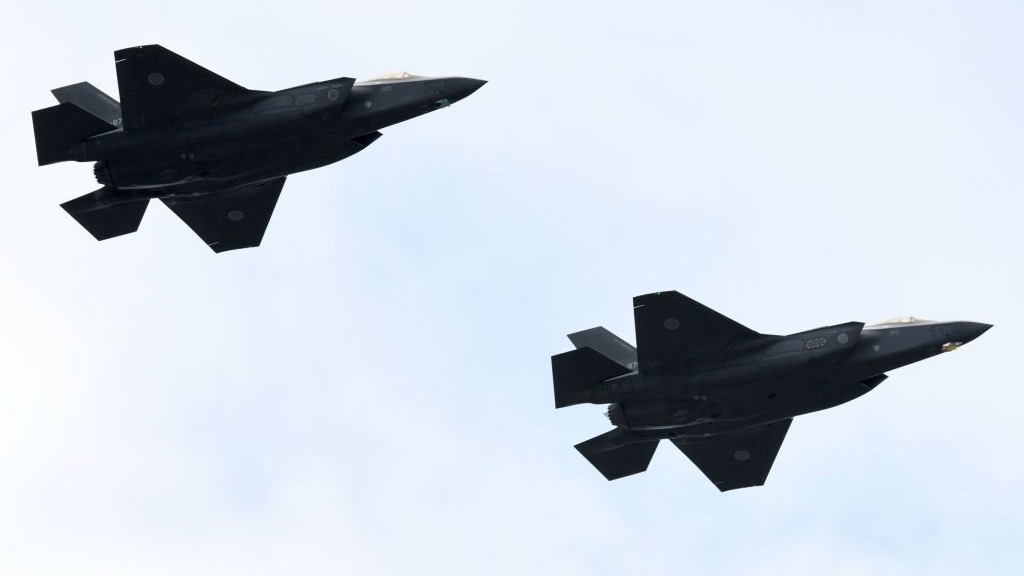 F-35 fighter aircraft from the Japan Air Self-Defense Force take part in a military review at the Ground Self-Defence Force's Asaka training ground in Asaka, Saitama prefecture, on Oct. 14, 2018. (Kazuhiro Nogi/AFP via Getty Images)