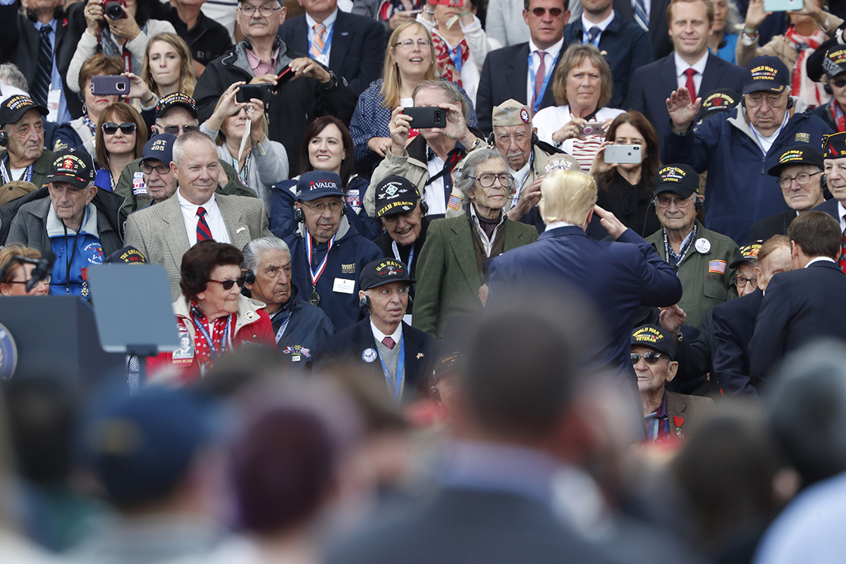 U.S. President Donald Trump salutes to veterans prior to a ceremony to mark the 75th anniversary of D-Day at the Normandy American Cemetery in Colleville-sur-Mer, Normandy, France, Thursday, June 6, 2019. World leaders are gathered Thursday in France to mark the 75th anniversary of the D-Day landings. (AP Photo/Thibault Camus/AP)