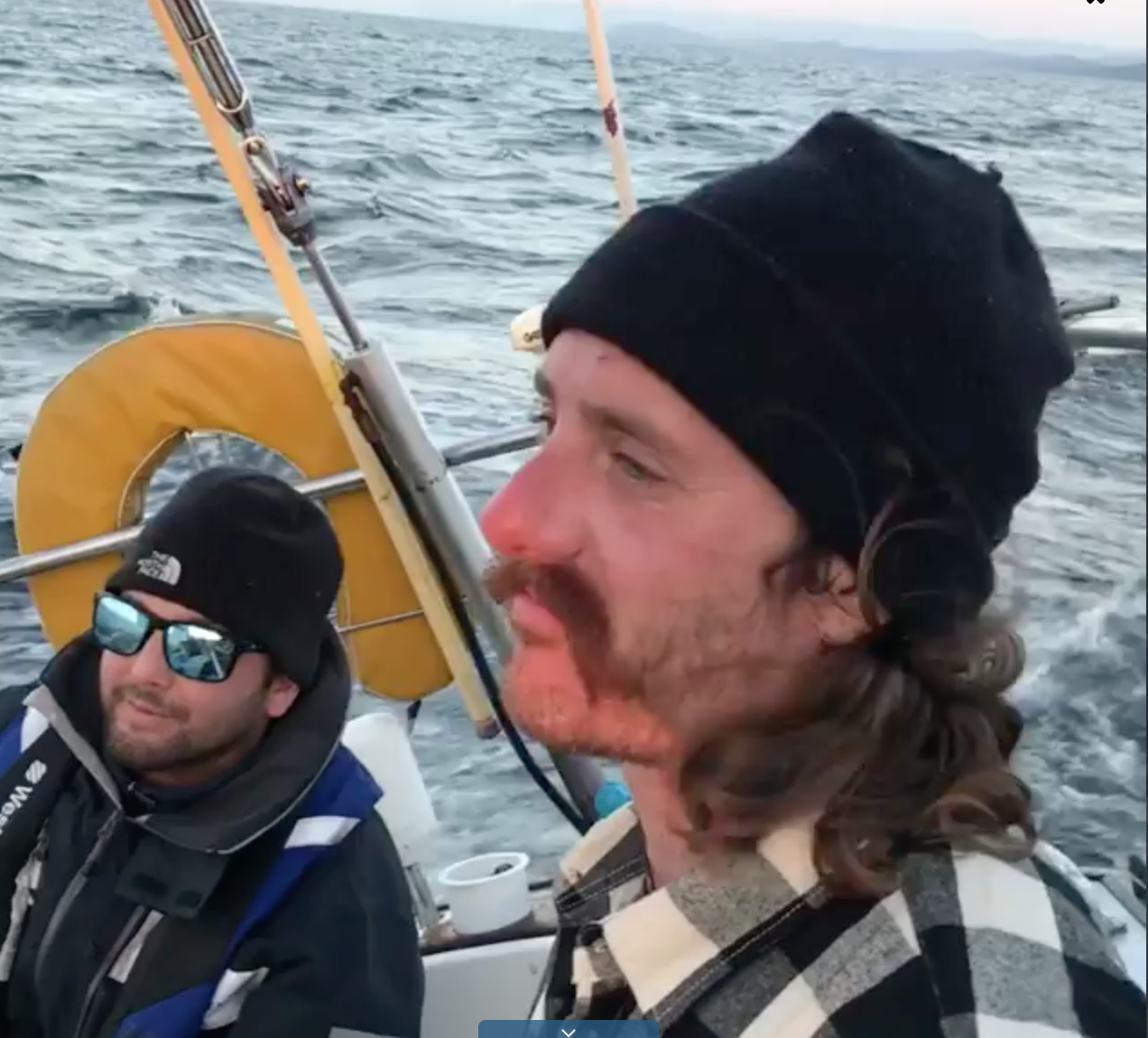 Stay Gold crew members Beau Romero, left, and Willy Kunkle stand watch pushing through the Strait of Juan de Fuca, which leads from Washington's Salish Sea (and Puget Sound) into the Pacific Ocean. (Courtesy of Ashley Bugge)