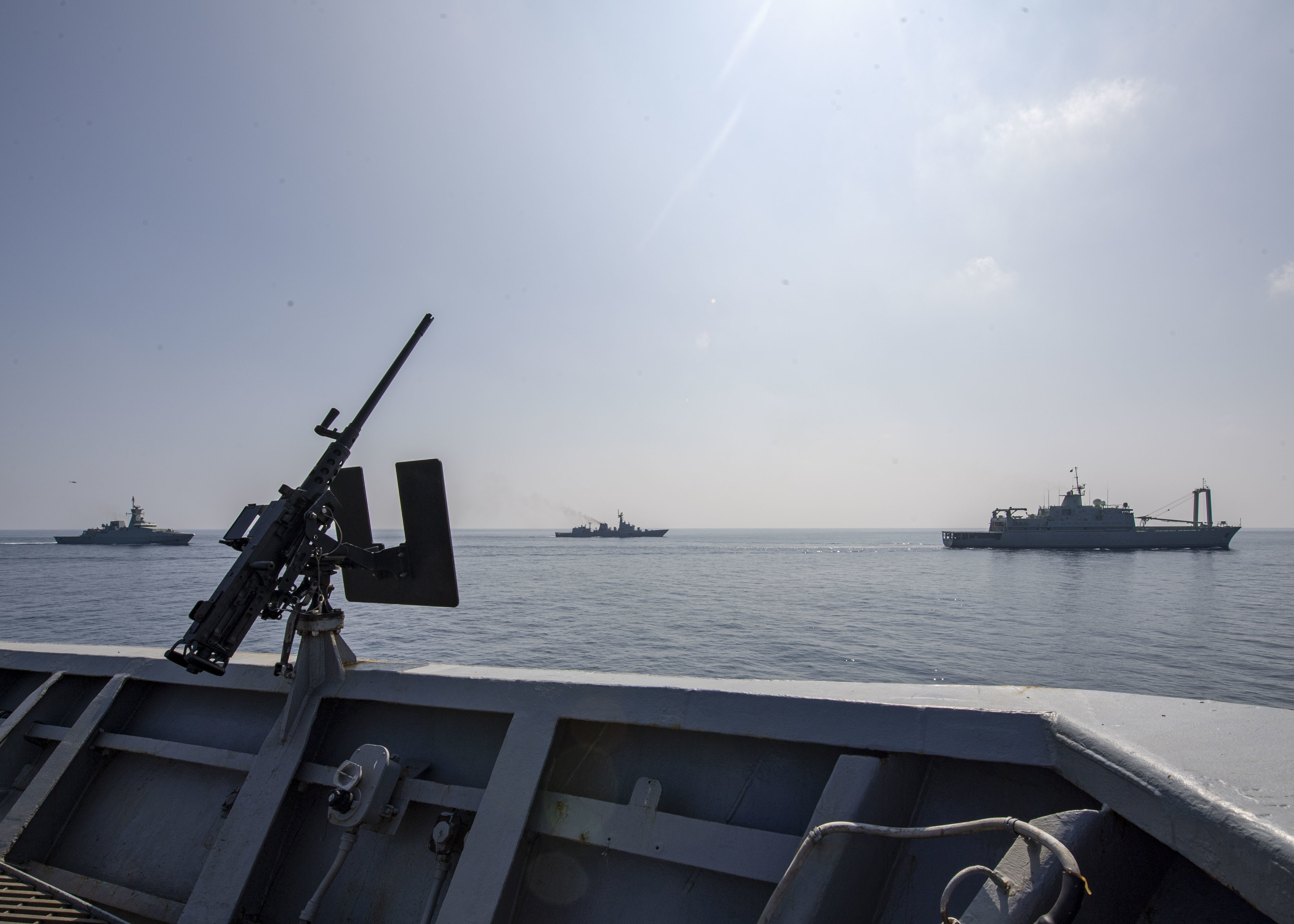 Ships from the Oman Navy travel alongside the USS Normandy during a multi-nation exercise in the Gulf of Oman on Nov. 6, 2019. (Mass Communication Specialist 2nd Class Michael H. Lehman/Navy)