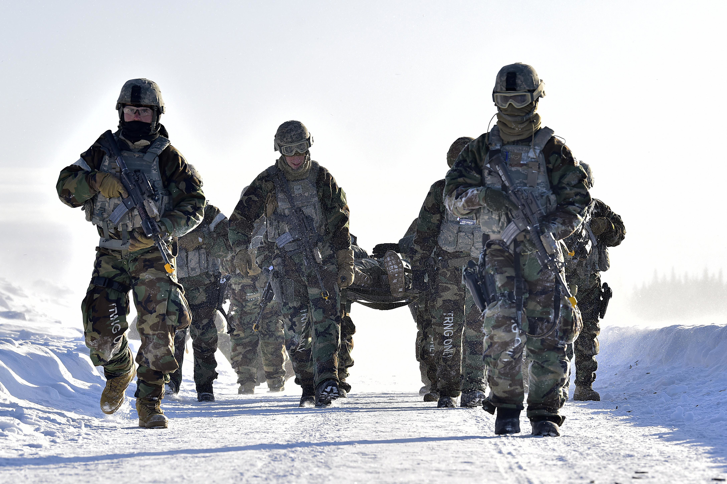 Airmen from the 354th Security Forces Squadron carry a simulated casualty during a medical evacuation exercise at Eielson Air Force Base, Alaska, Feb. 26, 2020. (Senior Airman Beaux Hebert/Air Force)