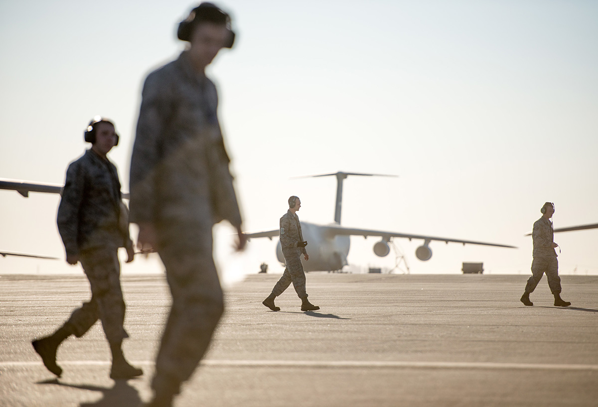 Aviation-related injuries resulted in at least 8,670 lost work days across the military over seven years. Pictured: Airmen perform a foreign object debris walk on the flight line at Travis Air Force Base, Calif., July 29, 2015. (Ken Wright/Air Force)