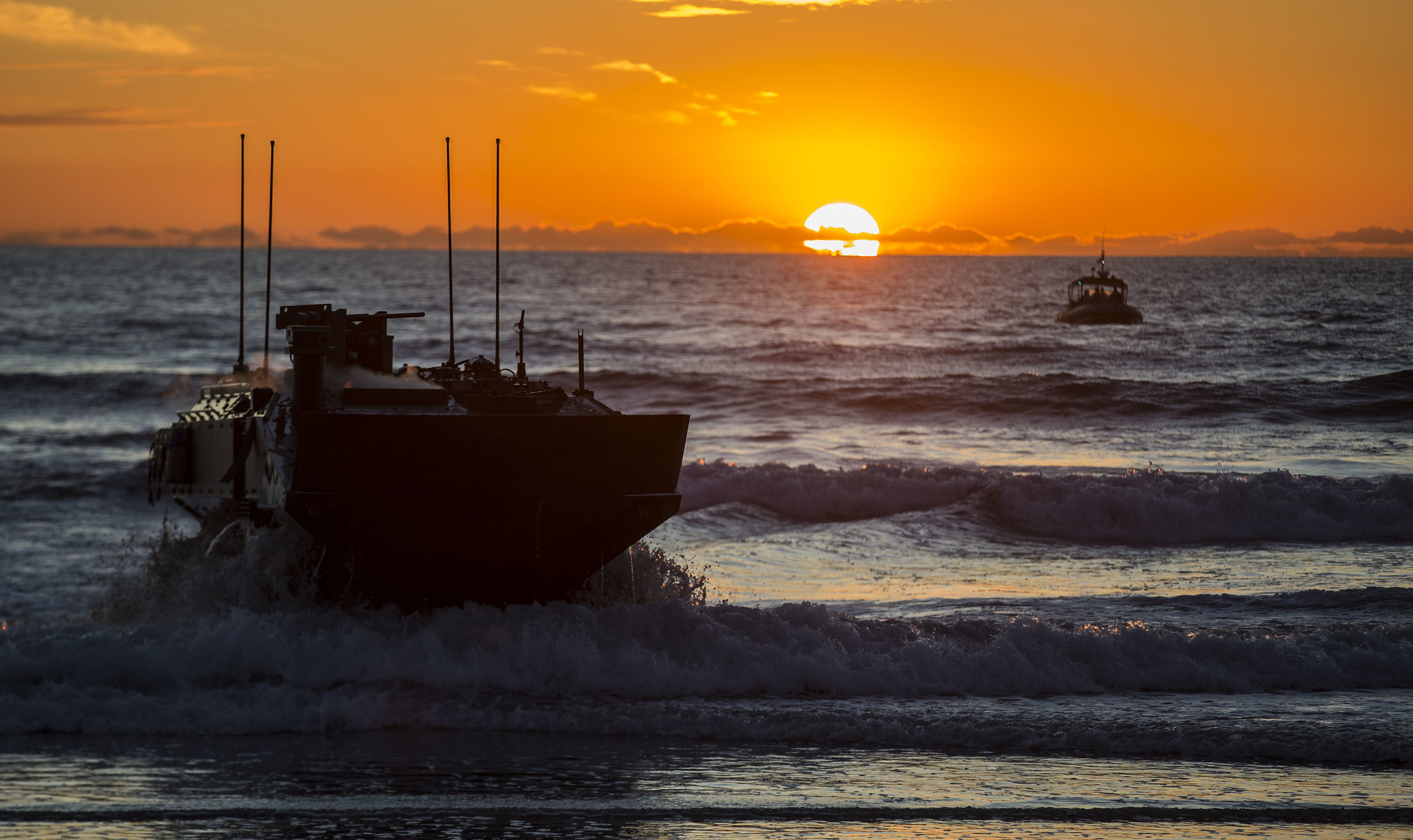 Marines with Amphibious Vehicle Test Branch, Marine Corps Tactical Systems Support Activity, drive a new amphibious combat vehicle ashore Dec. 18, 2019, during low-light surf transit testing at AVTB Beach at Marine Corps Base Camp Pendleton, Calif. (Lance Cpl. Andrew Cortez/Marine Corps)
