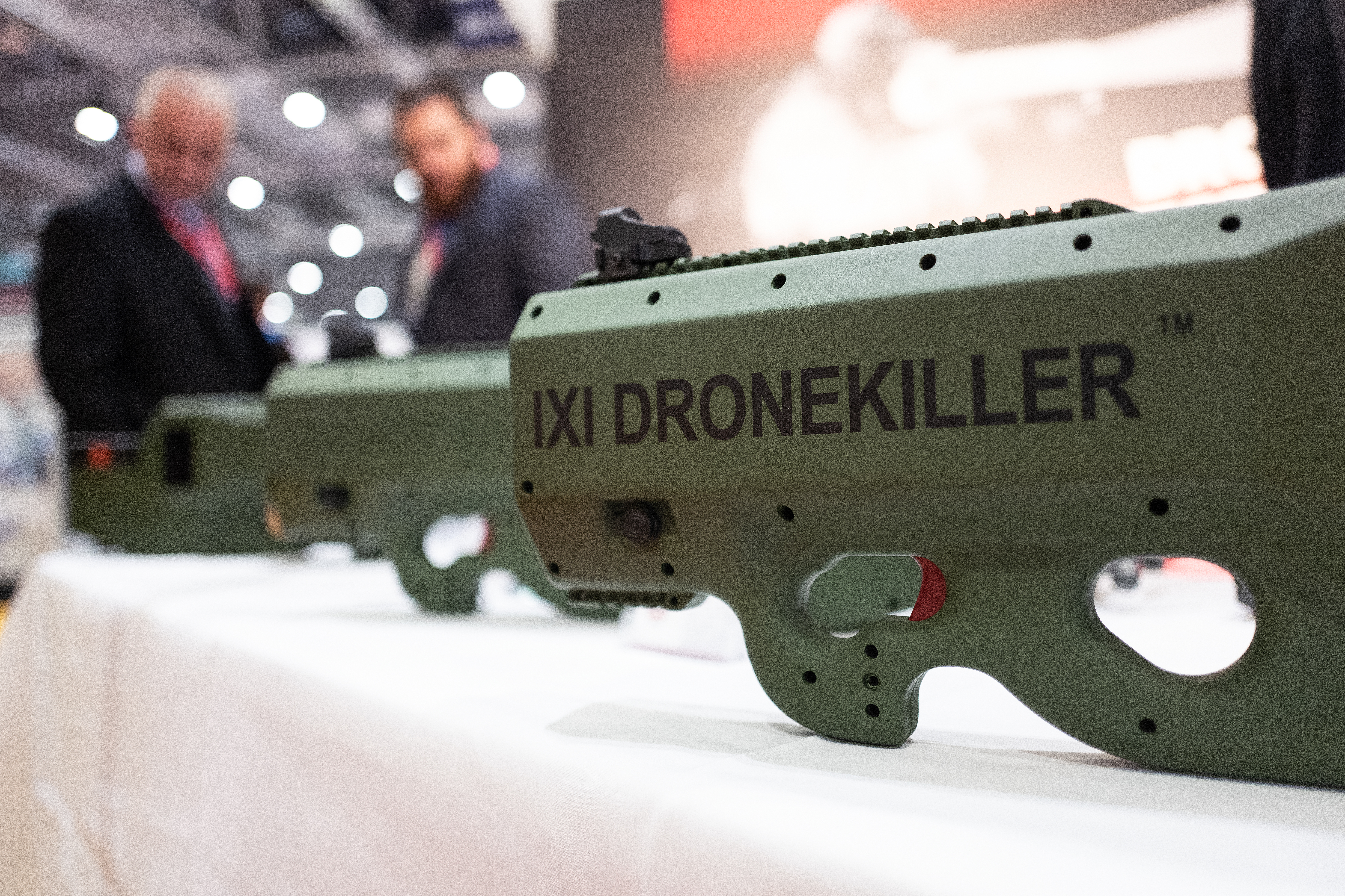 On the opening day of the DSEI arms fair, delegates look at the IXI Dronekiller system. (Leon Neal/Getty Images)