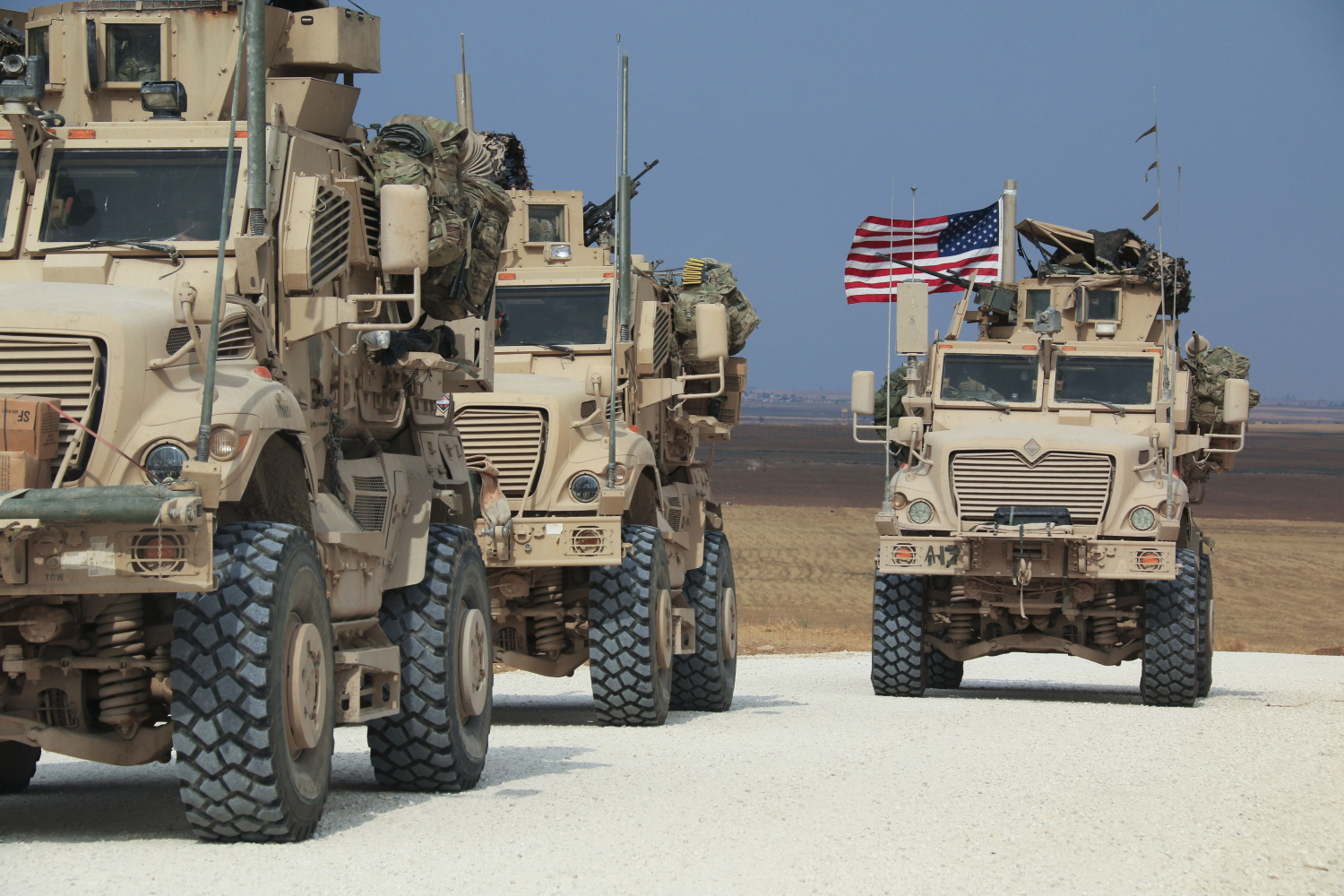 An American military convoy stops near the town of Tel Tamr, north Syria, Sunday, Oct. 20, 2019. (Baderkhan Ahmad/AP)