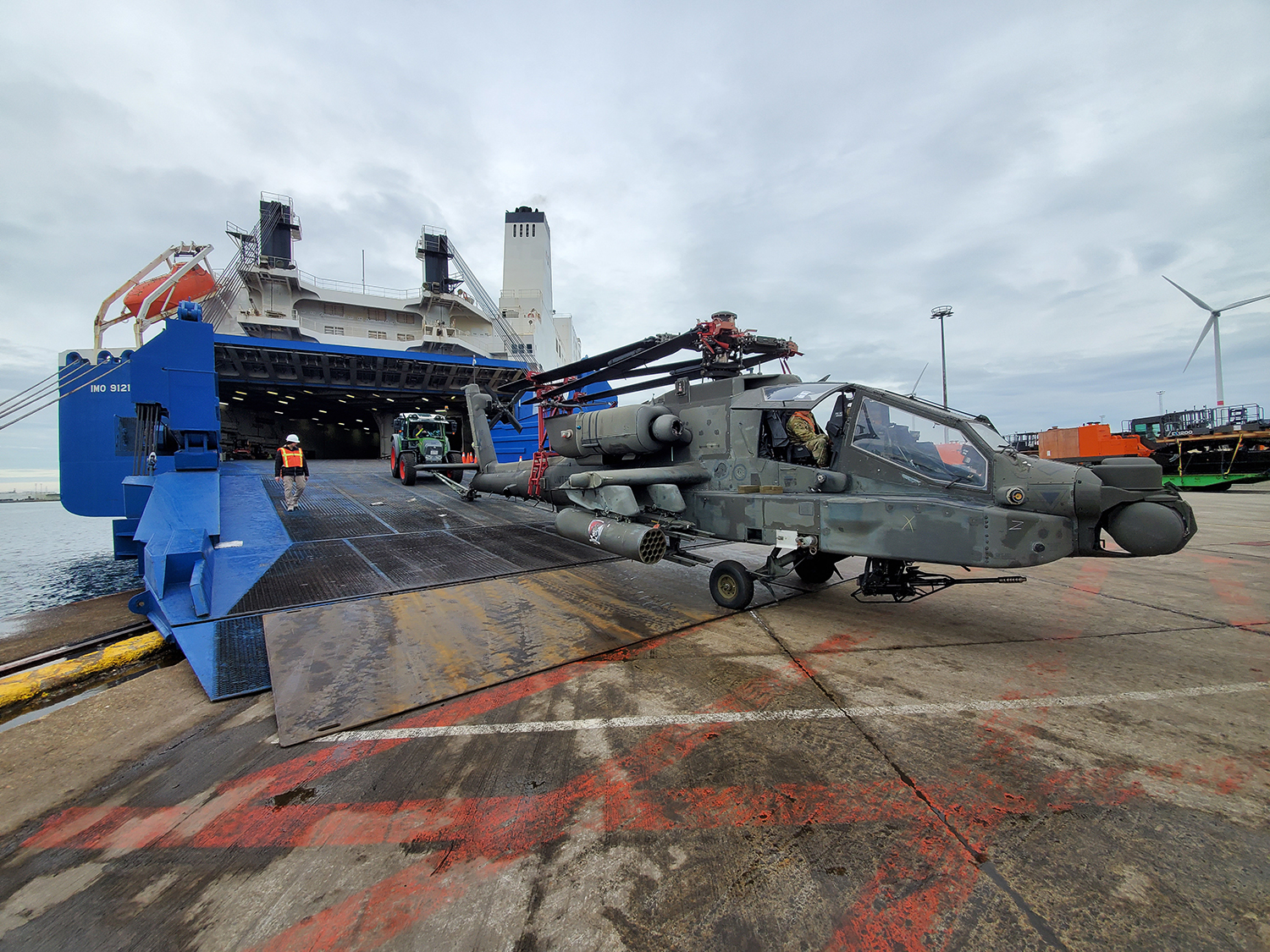 An AH-64 Apache is offloaded from a shipping vessel at the Port of Zeebrugge, Belgium, Oct. 15, 2019. (Sgt. 1st Class Aaron Duncan/Army)
