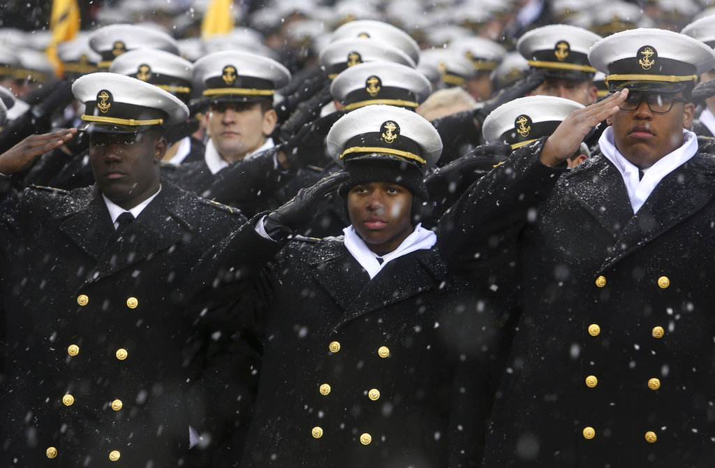 Navy Midshipmen salute during the national anthem just before the 118th meeting of Army West Point and Navy on Saturday in Philadelphia. (Jacqueline Larma/AP)