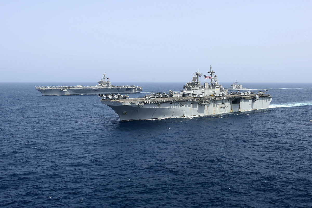 The amphibious assault ship USS Kearsarge sails in front of the USS Abraham Lincoln aircraft carrier on May 17, 2019, in the Arabian Sea. (Mass Communication Specialist 1st Class Brian M. Wilbur/ U.S. Navy via AP)